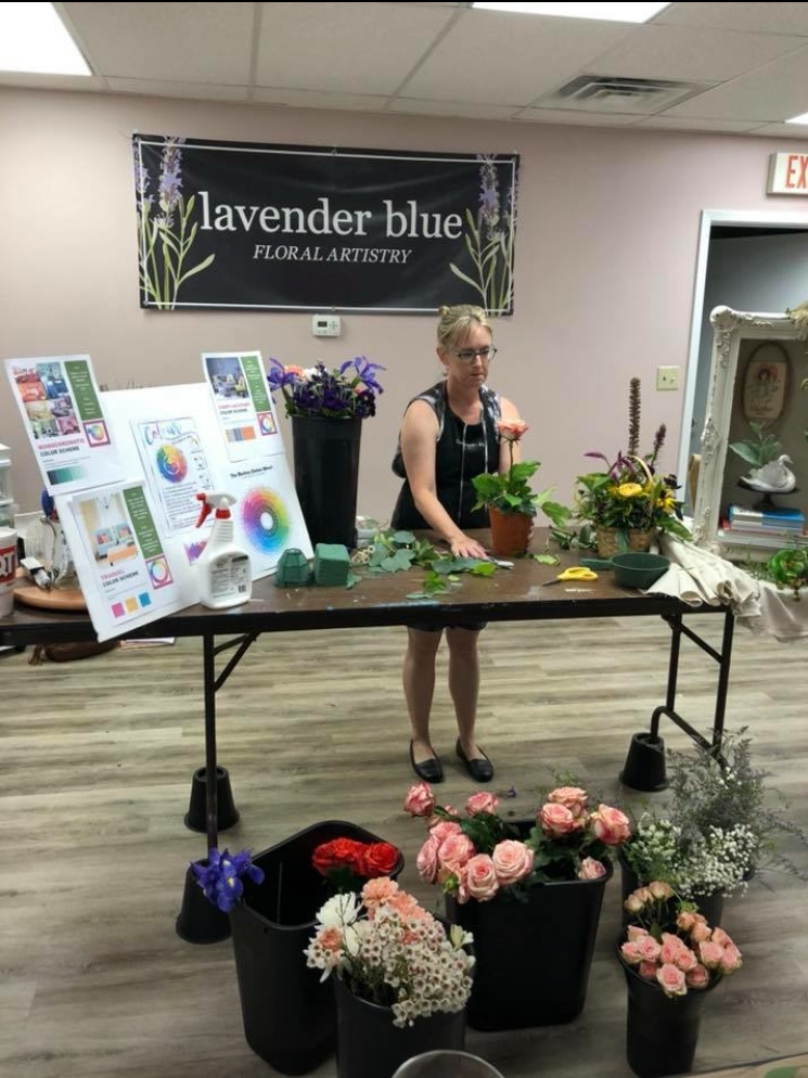 """Here is the owner, Lynda O'Hara, at the work table for one of our classes! We were so happy and proud to be able to host a learning experiencing for people in the Des Moines area, where we could come together as friends and """"creative soul sisters"""" , making floral arrangements and laughing about the latest happenings in our busy lives."""