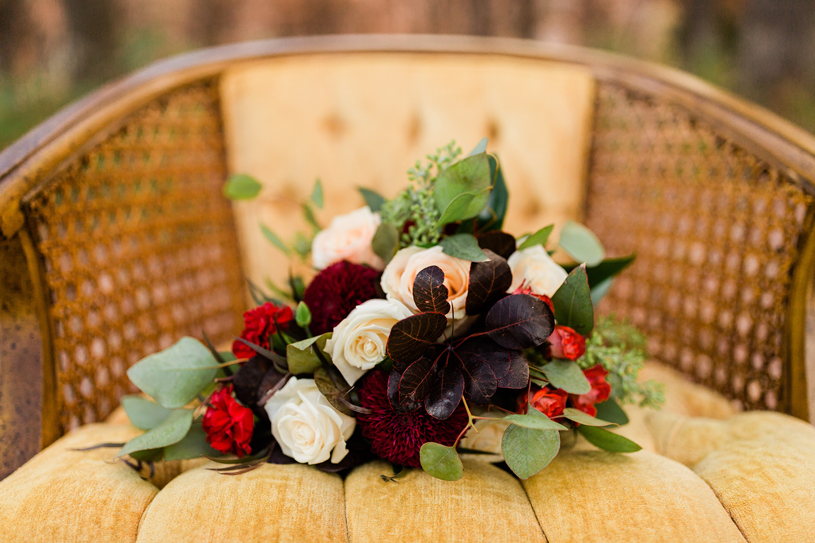 fall and winter bouquets with purple and red flowers roses eucalyptus leaves