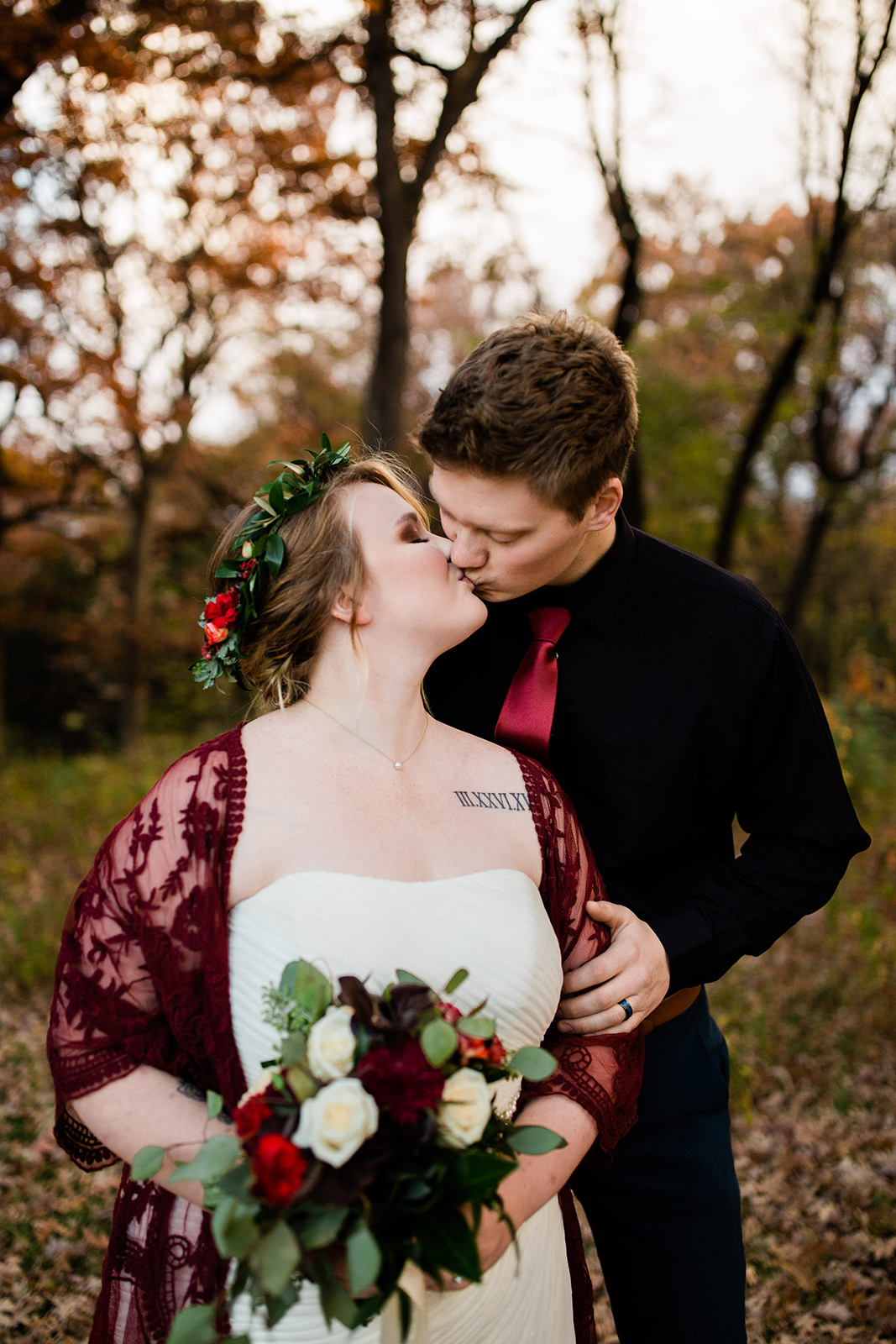 couple kissing at favorite fall wedding venues in Des Moines Iowa