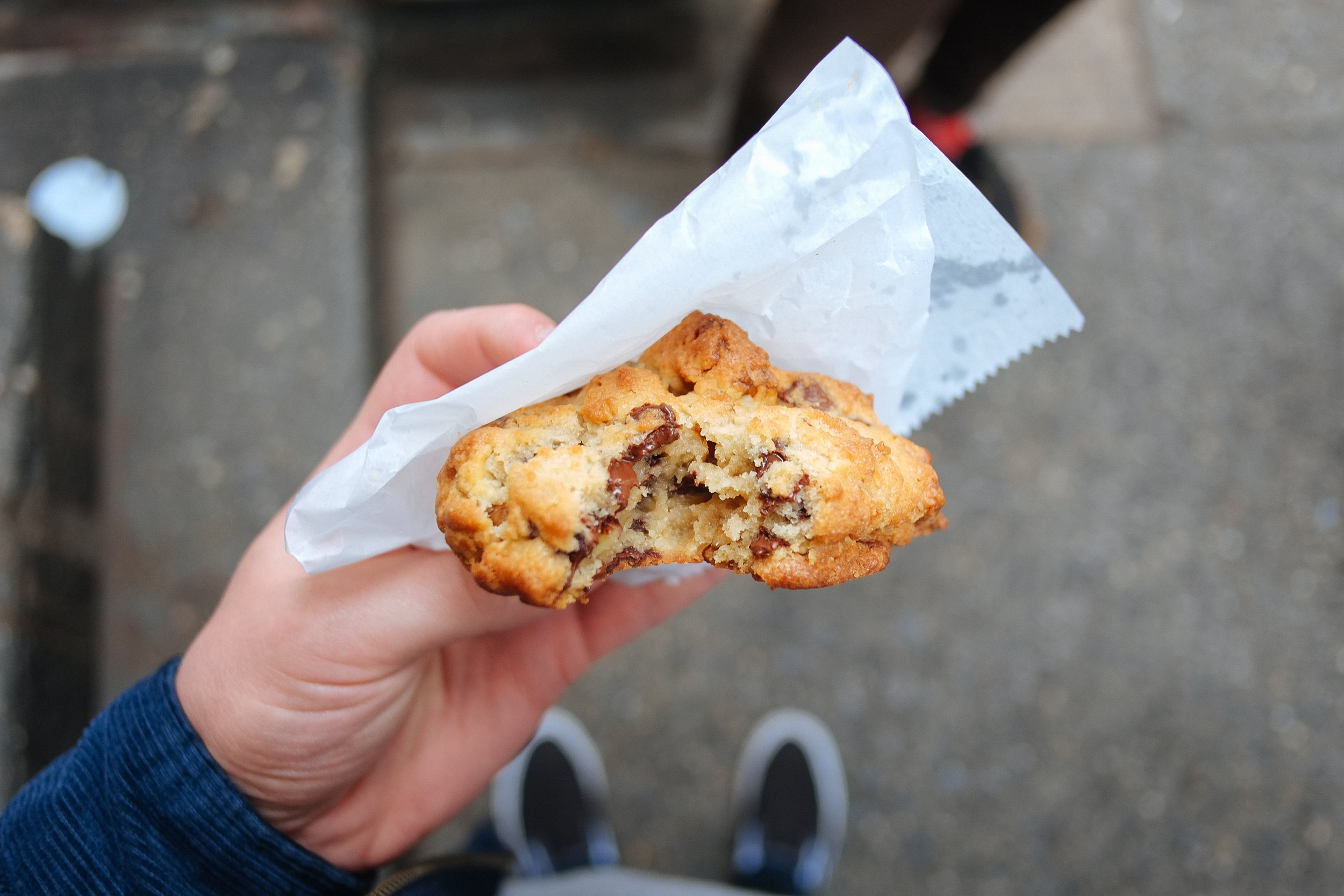 Levain Bakery, NYC - 2018-05-13: Fresh out the oven, melt in your hand, small batch cookies. The only cookie shop with a line cam (I'm pretty sure...) The cookie in my hand is the chocolate chip walnut.