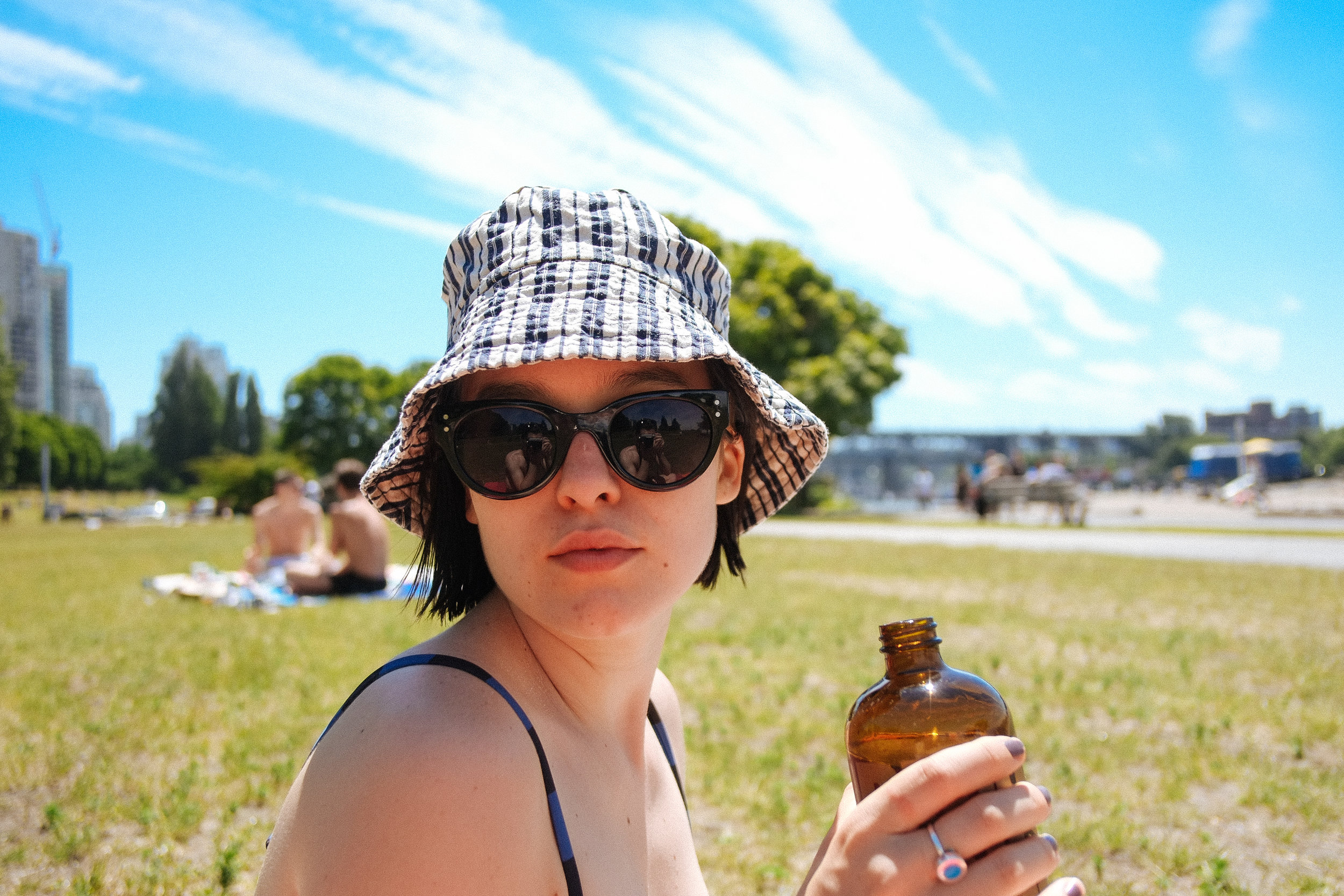 Summer Bike Hops - 2018-06-18: Raspberry Changeling's to-go, taken down to Sunset Beach, Vancouver, BC. Set up with Nicholas, a blanket, a bosé, and spf 30 (50 for the nose.) Daniella stopped by early, and a bunch more friends stopped by. Early departures from the few with Dad's in the city for Fathers Day. The first real feeling of that summer heat.