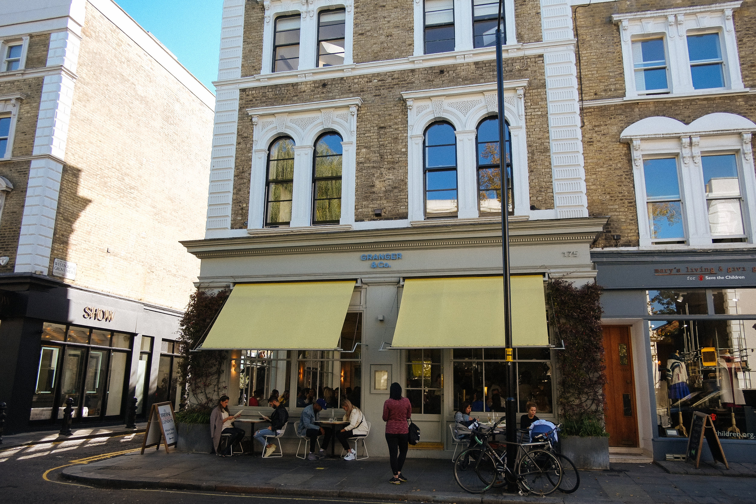 Granger & Co., Westbourne Green, UK - 2018-10-09: This was one on the MUST list. Granger & Co. in the Westbourne Green district of London. I had the black lentil daal with a poached egg and a much deserved coffee. We sat at the bar and was a great first meal in London.