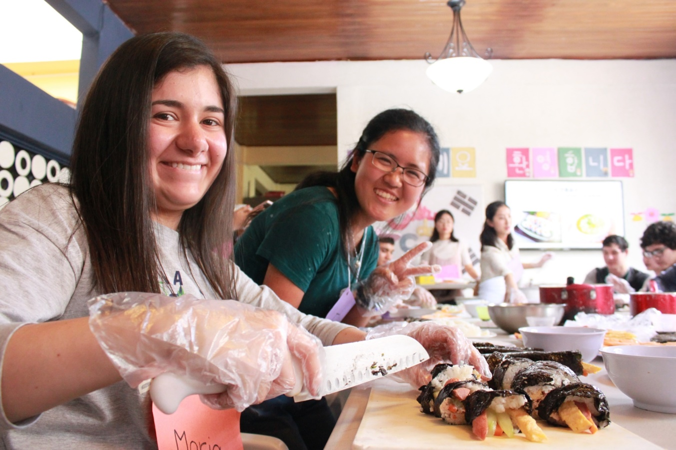 Fuyu, and one of her guests, Maria, make kimbap for lunch at the Korean Culture Event on Friday!