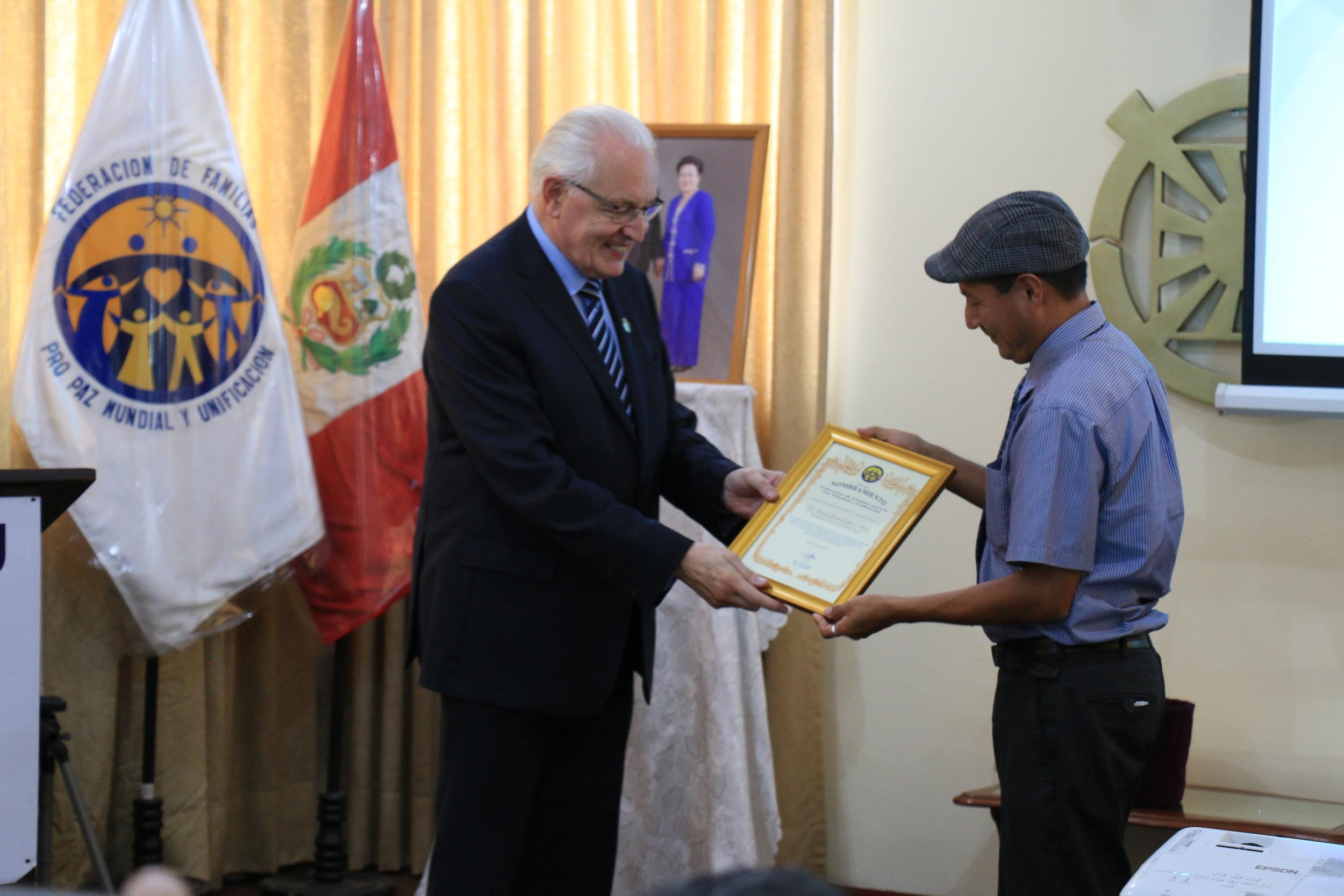 2.3 - Leadership Change, Senor Omar receiveing plaque.jpeg