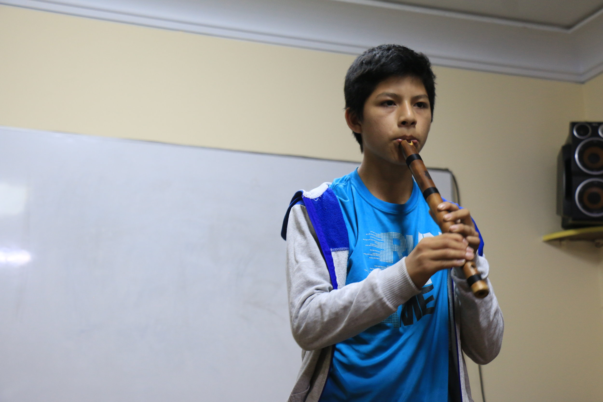 High School Participant Playing a Traditional Peruvian Recorder