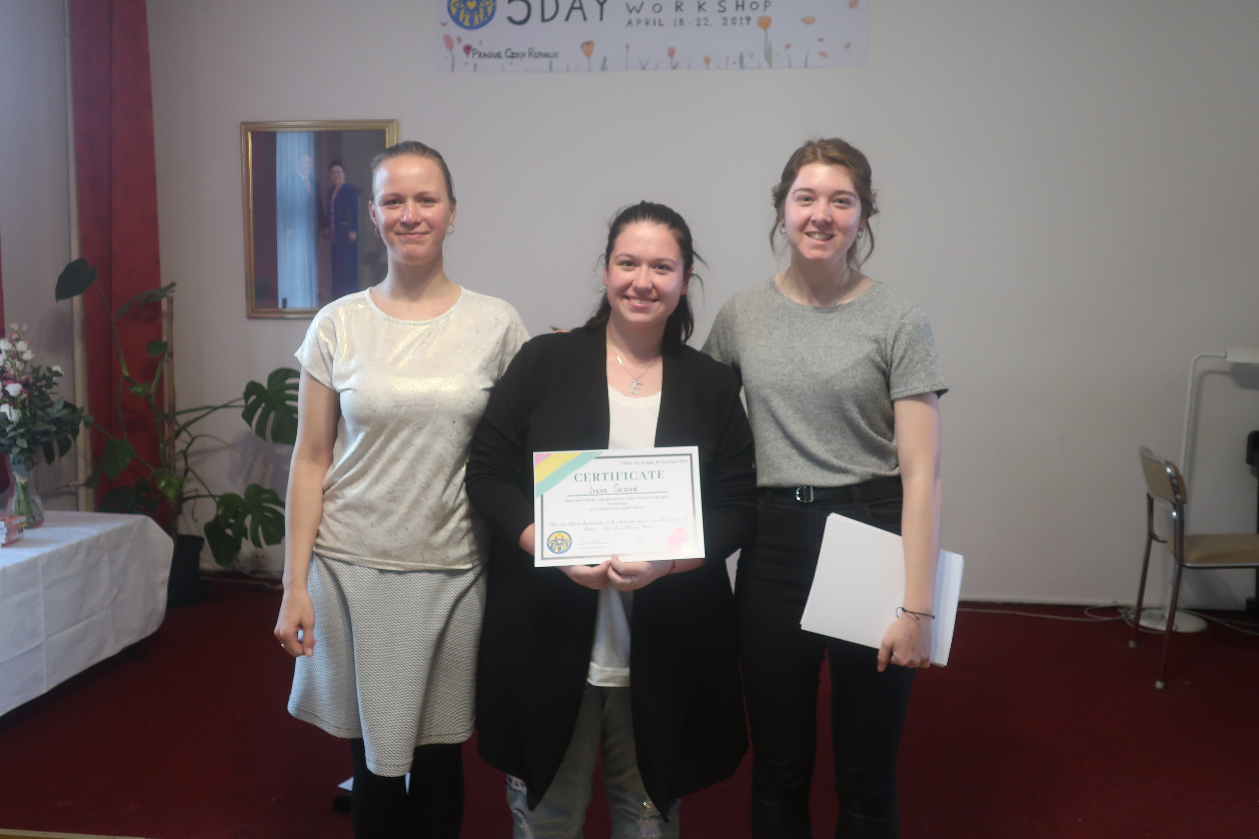 Handing certificates of graduation from Eva and Vicky, host and MC of workshop