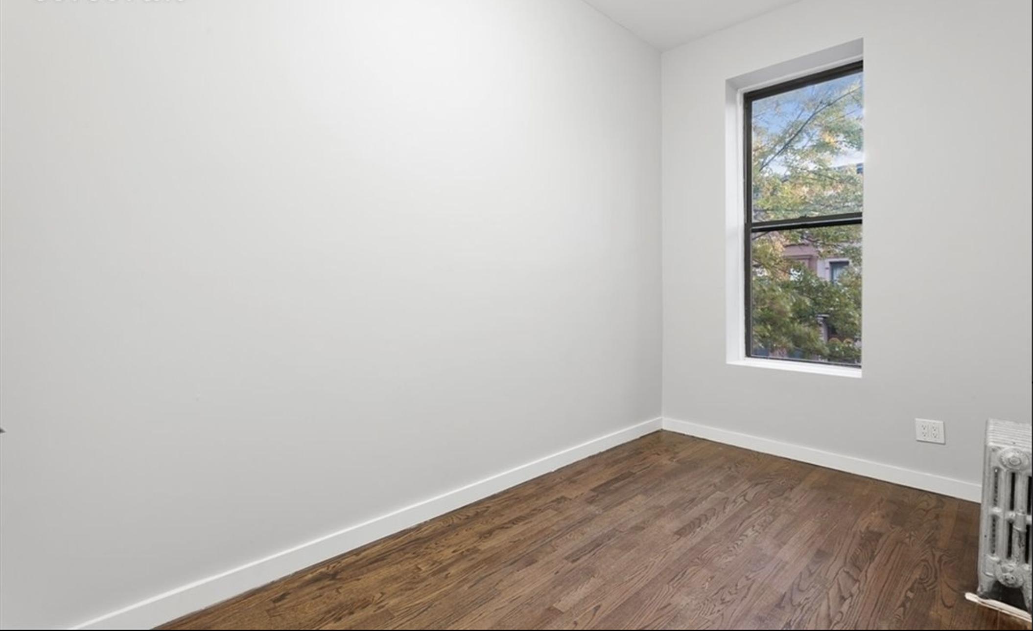 211 Jefferson Avenue Bedroom.png