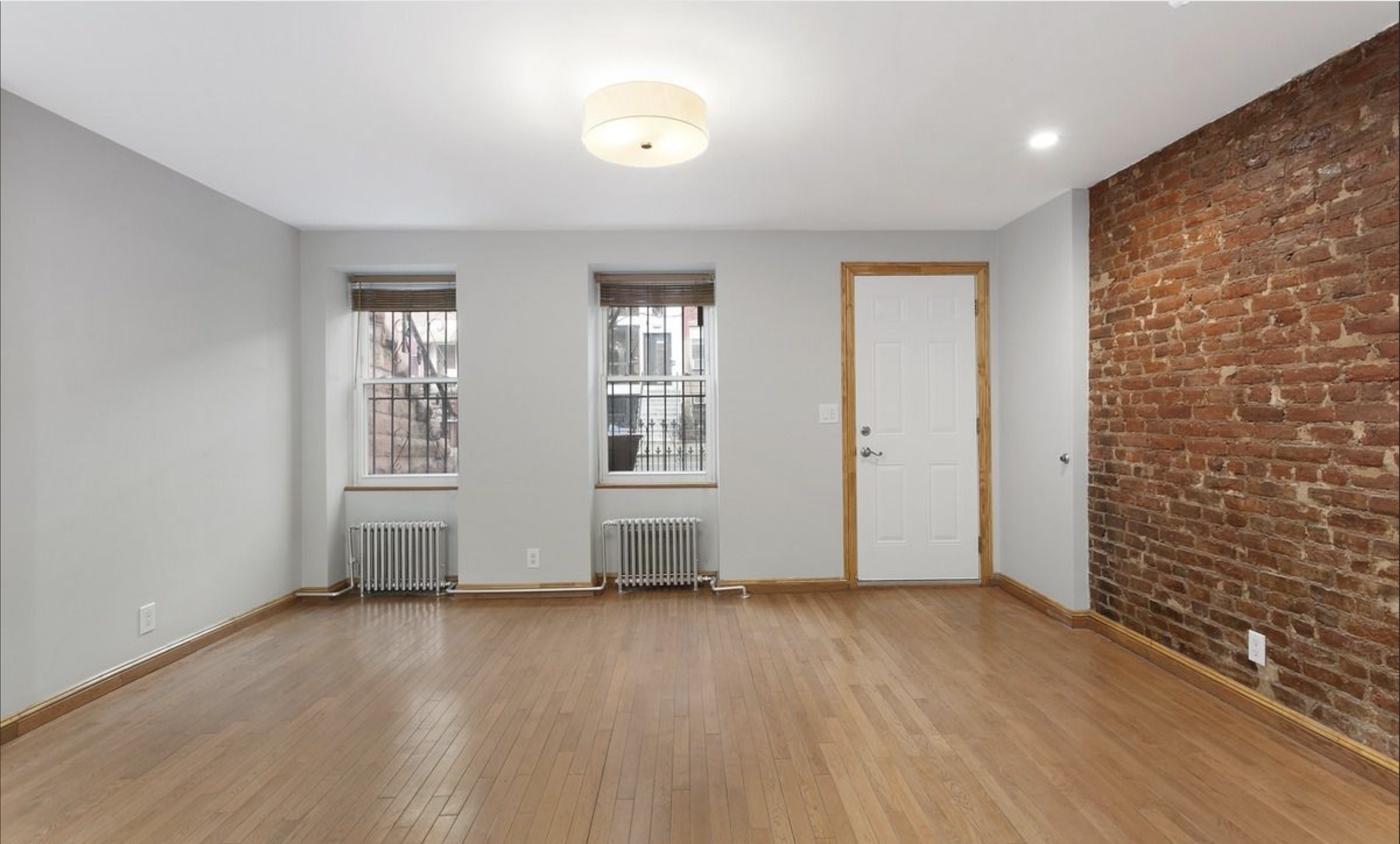 615 Halsey Street Living room with exposed brick.png