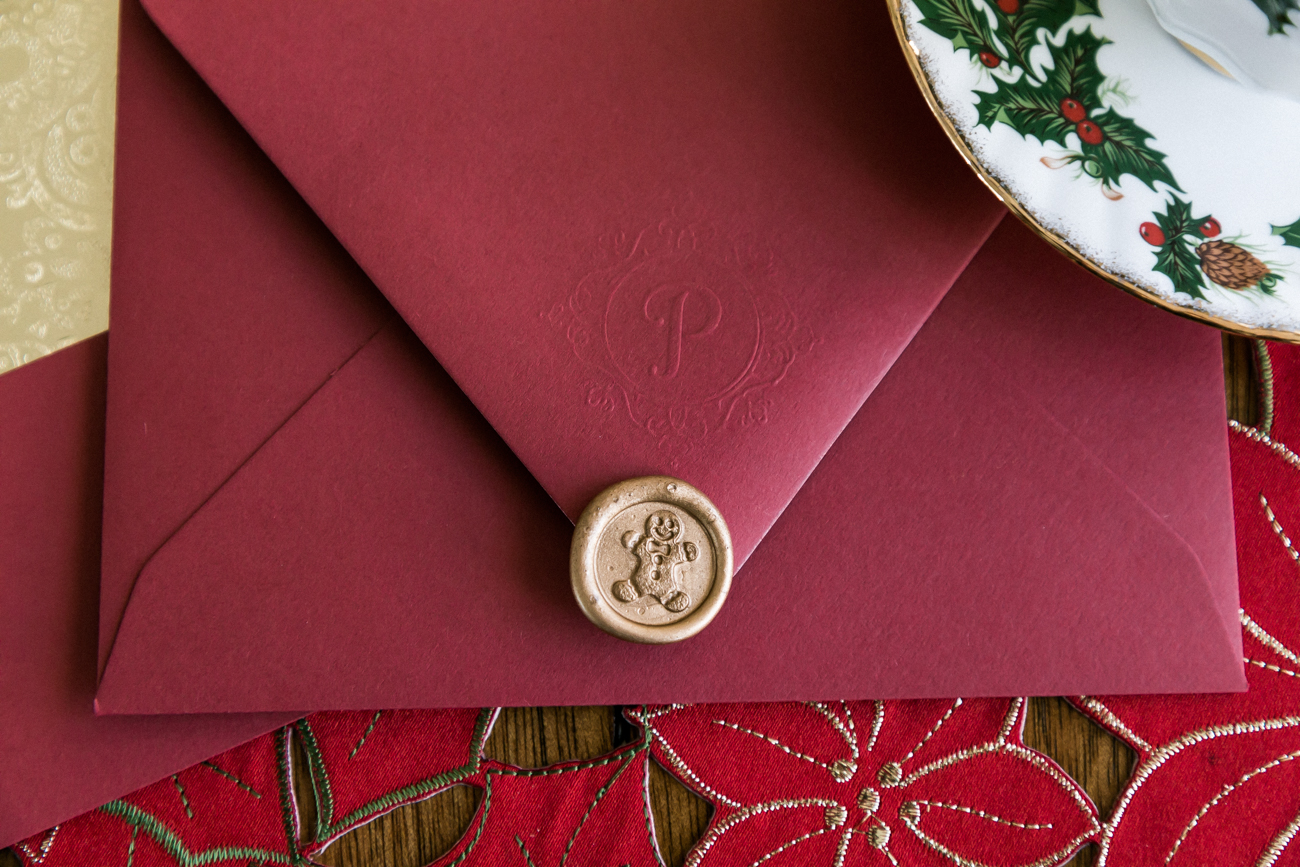 Embossed initial and a gingerbread man wax seal.