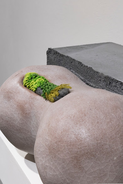 Laura Primozic,  Microenvironments 3 , concrete, earthenware, textile. Moss-like strands of green, yellow, and gray form a rectangular line on a bulbous earthenware shape.Image courtesy of Lucas Stiegman.