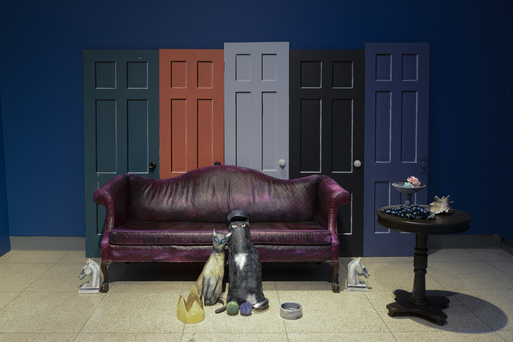 The installation by Donna Castellanos has two cats to be posed, a couch and the doors, just as they can be seen in Abercrombie's paintings. Visitors come through to take their own pictures inside the installation as if they are within one of Abercrombie's paintings. Image courtesy of the Illinois State Museum.