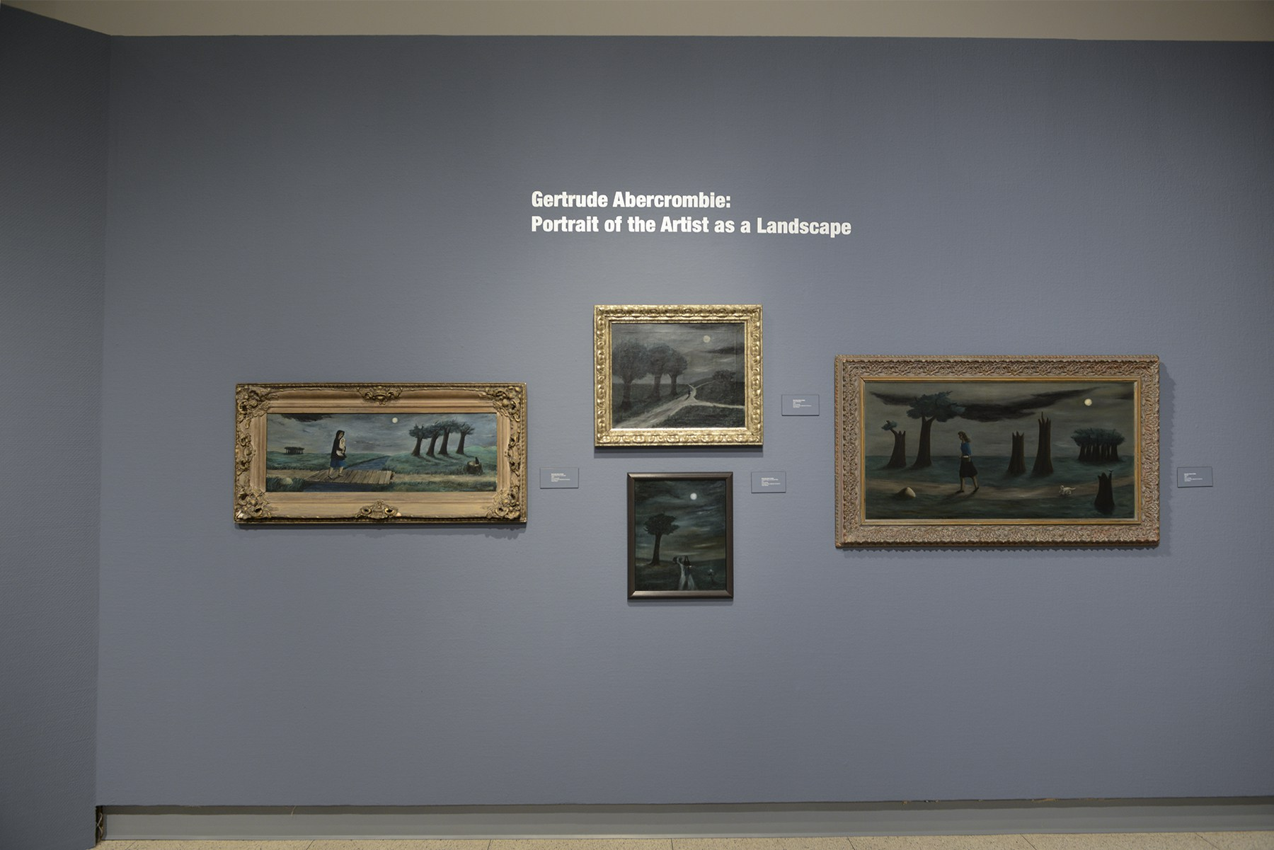 The back wall of the Abercrombie exhibition has four paintings, each of Abercrombie walking along a moonlit path. Image courtesy of the Illinois State Museum.