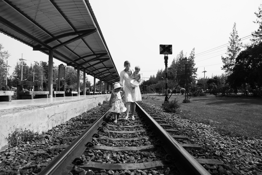 family-walking-on-train-track-1.jpg