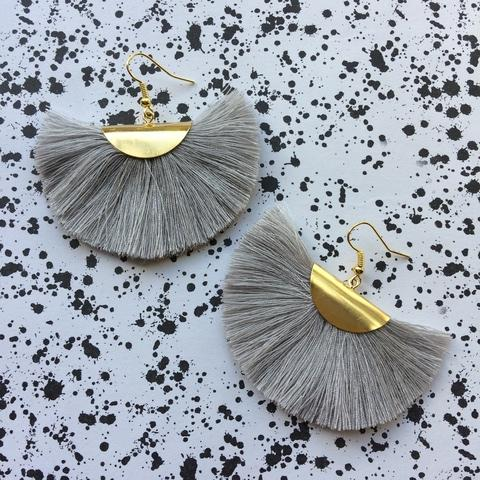 handmade by kylie at  jack & freda , these fun tassel earrings are an easy way to commit to the trend. there are some other pretty bold colours available but i love this grey.