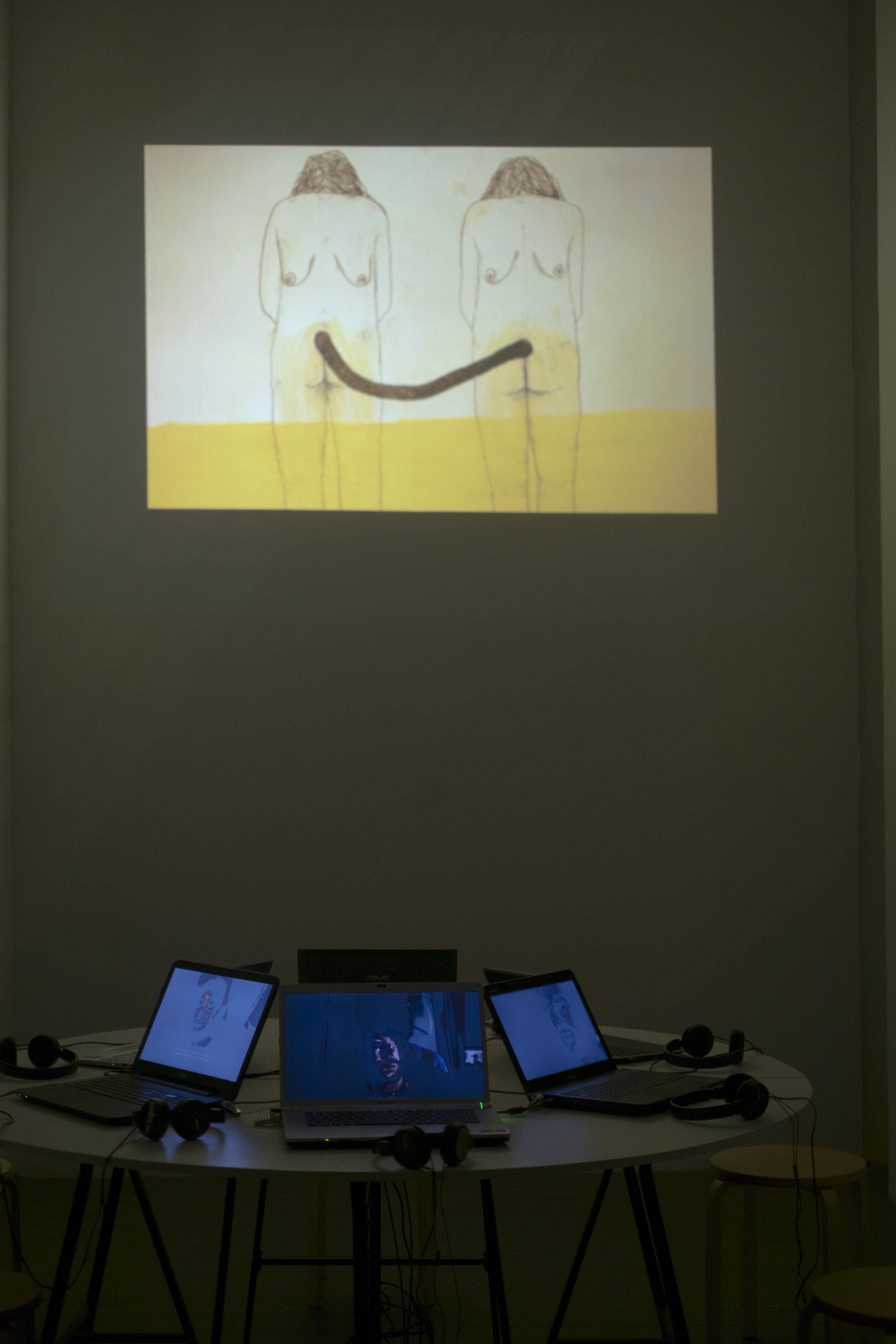 """Exhibition view - (Above) Video animation loop titled """"Urine""""  Below work of Omer Even Paz ( Interstitial Space )"""