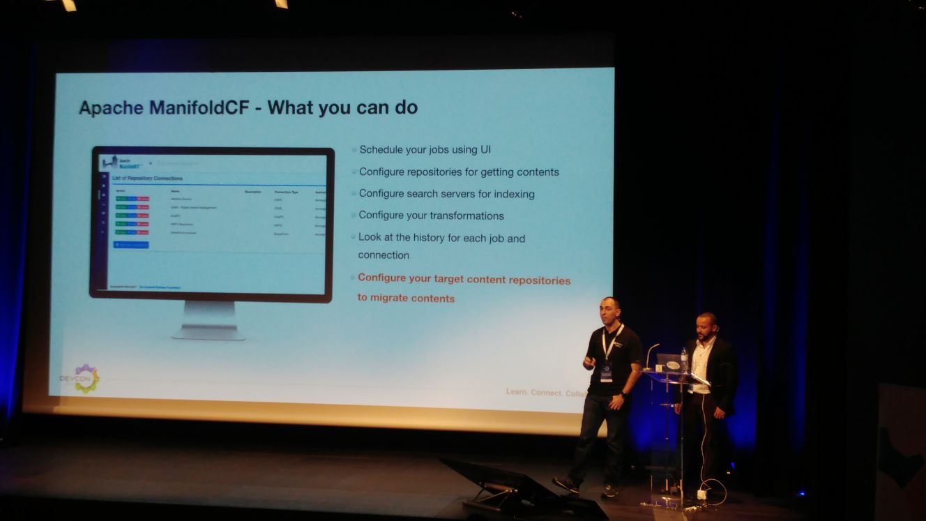 PJ with Luis on the stage talking about Content Migration