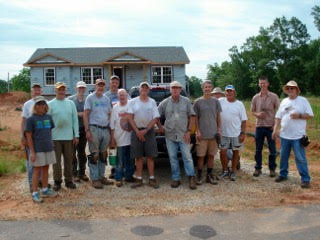 """- """"Motley Crew"""" - Most of the regular volunteer construction crew who built the Butler School Road subdivision"""