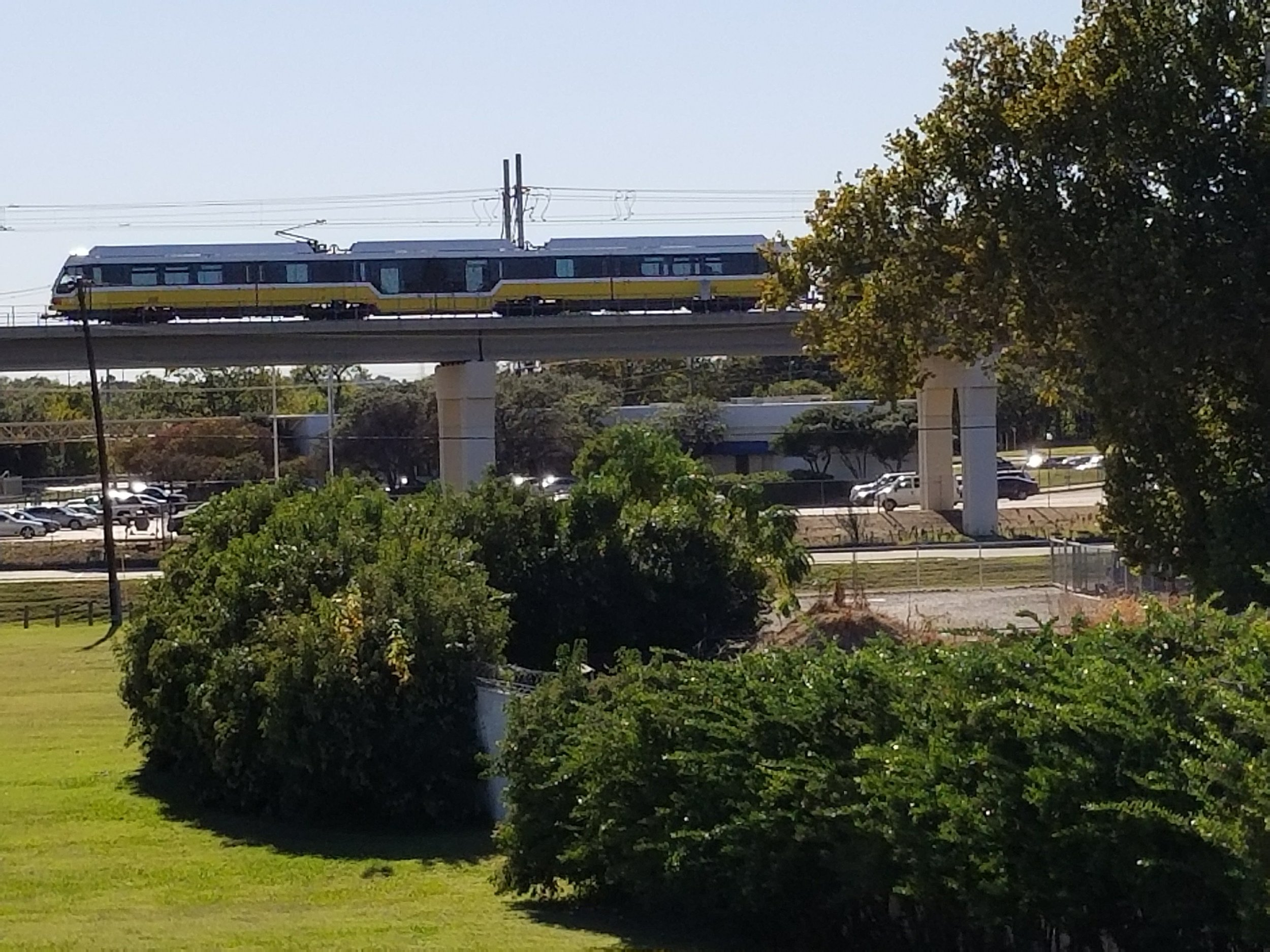 View of the DART train passing by the Bachman Lake Skatepark