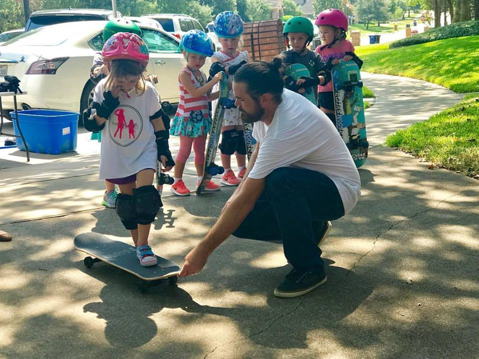 Josh helping a young skater get started on her board