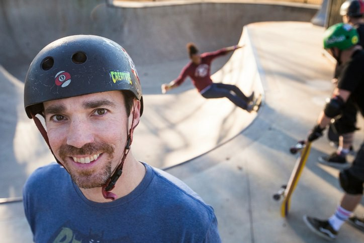 Dr. Clinton Haley skating a bowl with friends.