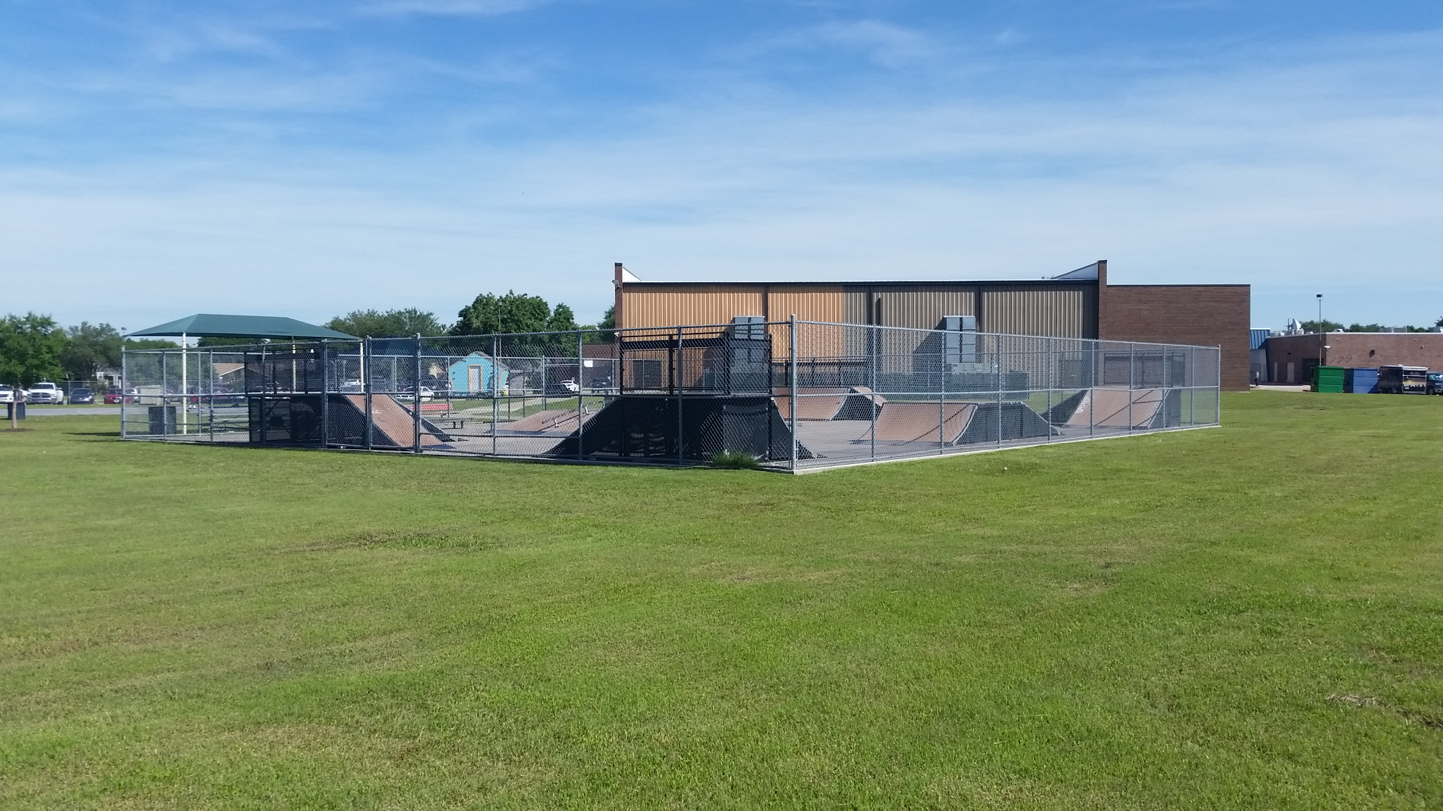 The chainlink fence makes for an uninviting space, and the modular ramps have a limited lifespan