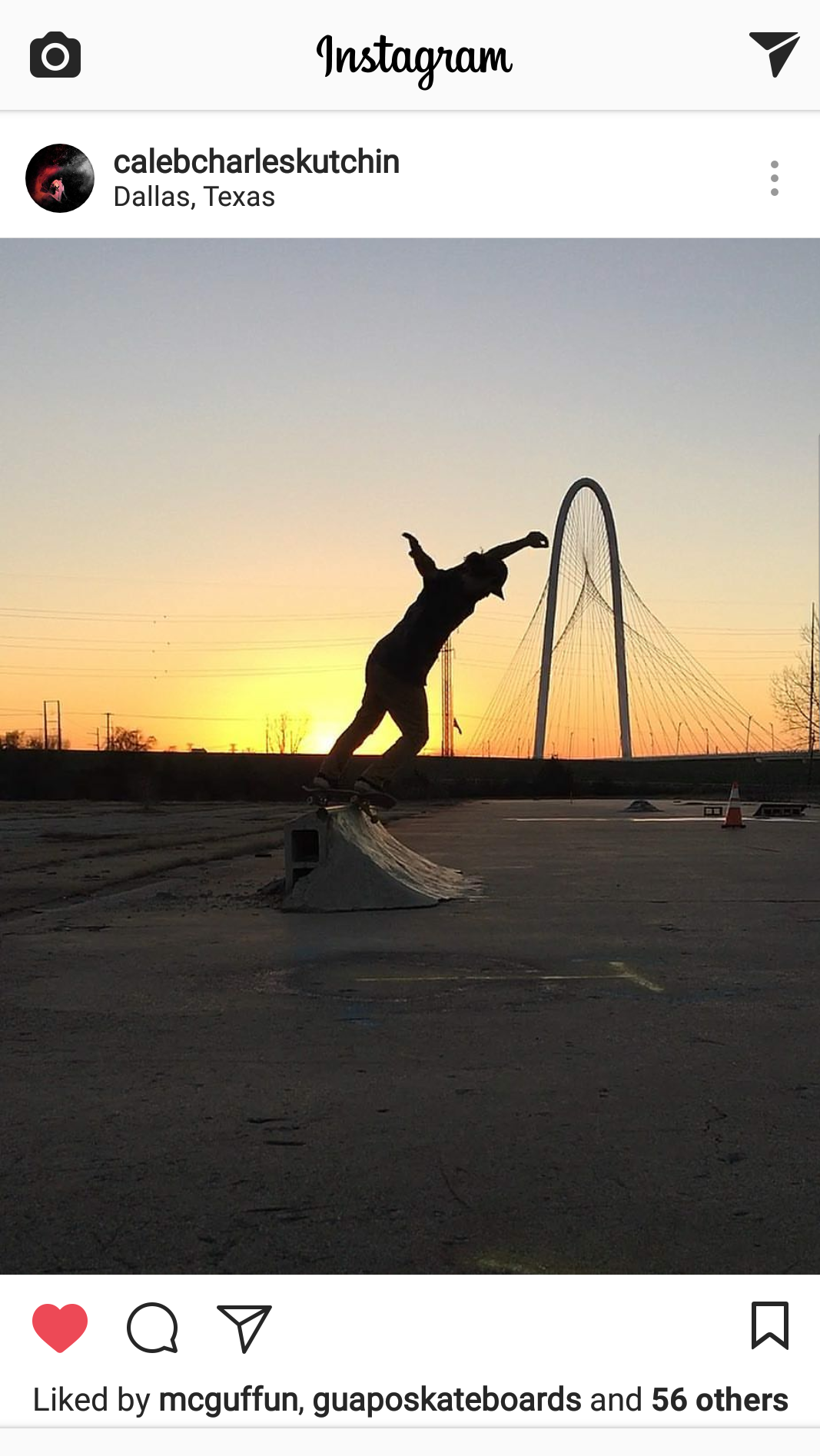 Dallas skater Caleb Kutchin skating against a silhouette of the Margaret Hunt Hill Bridge in Dallas