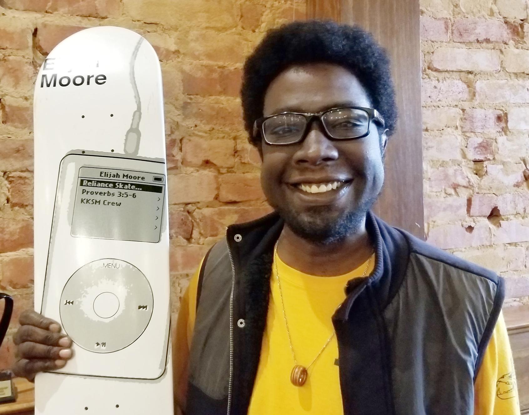 Elijah with his 2nd pro-model skateboard, featuring an original iPod