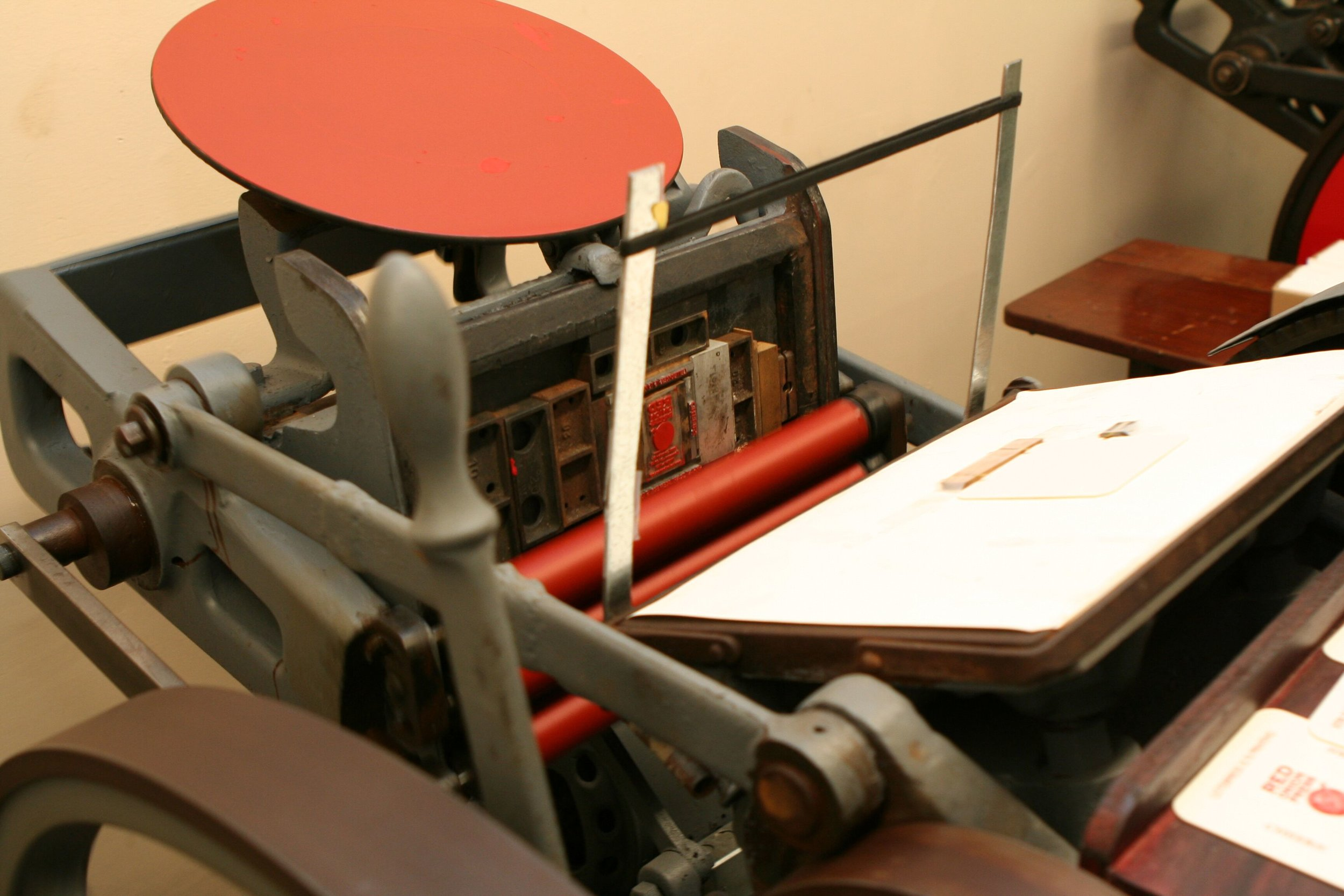 And then transfers the ink to the type and logo