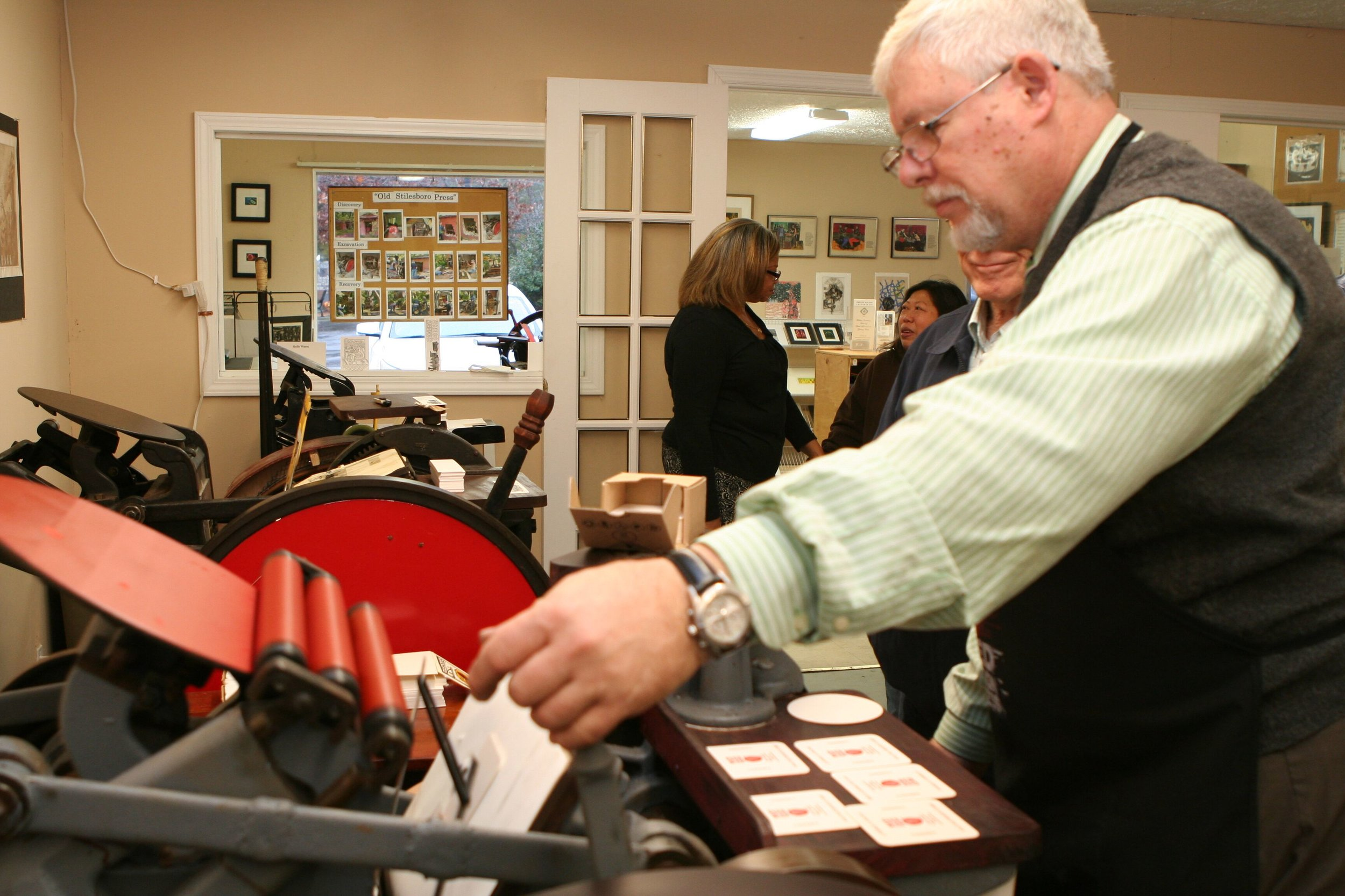 Then the thowout lever is pulled back to engage the press and transfer the ink to the cardstock