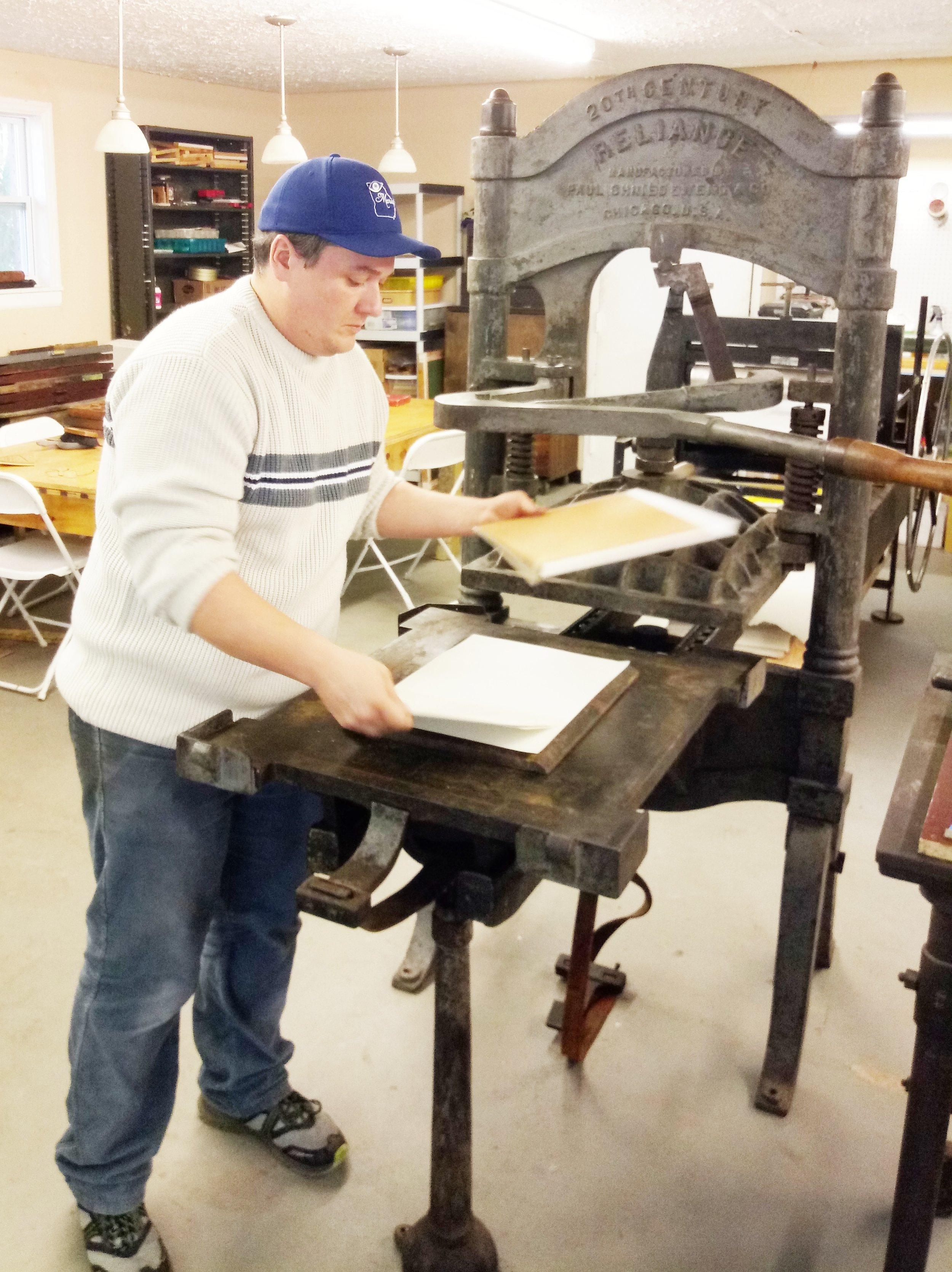Executive Director and Master Printer, Nuno Nunez checks the print