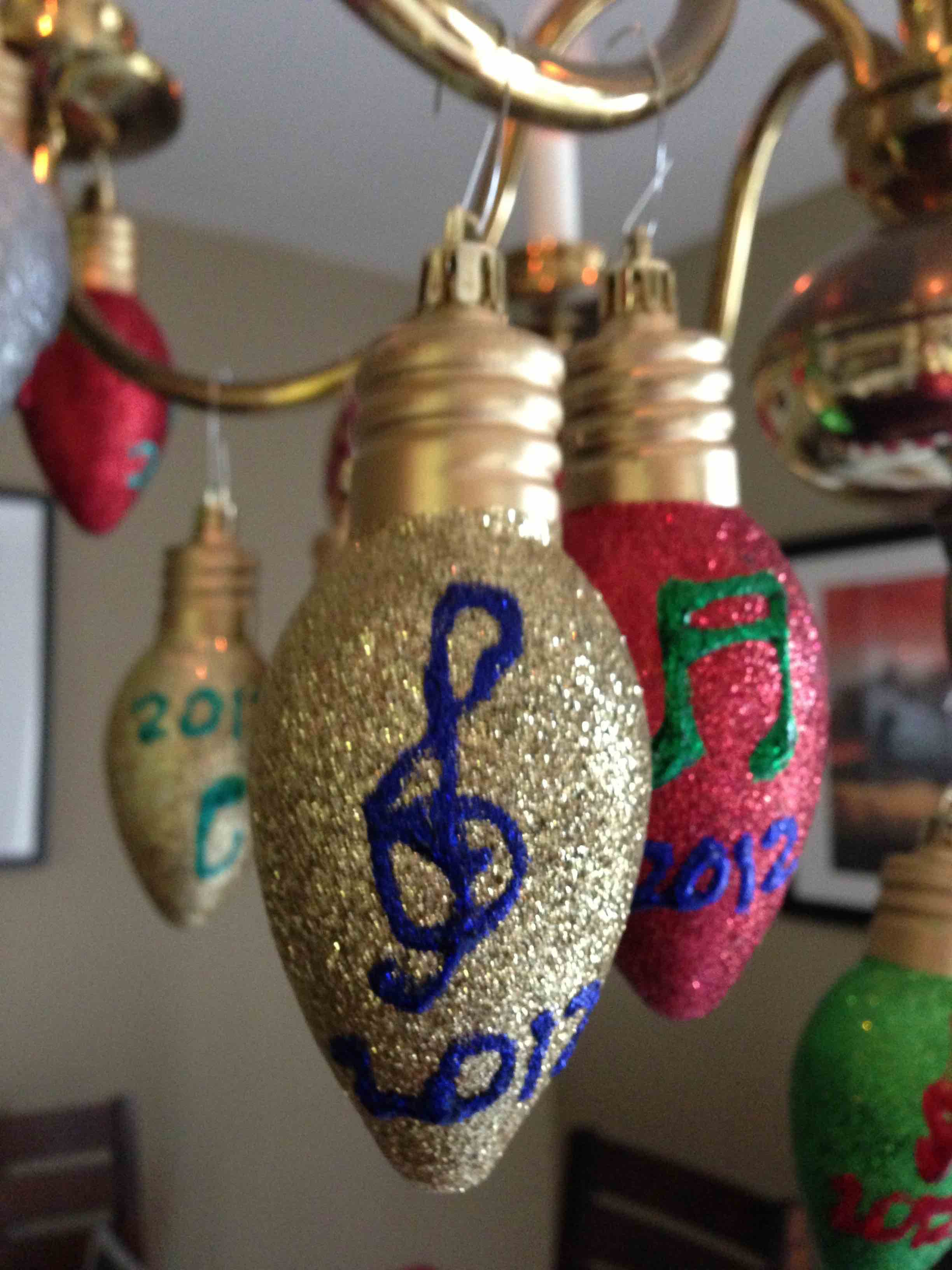 Decorate  - Buy decorations in bulk and use glitter glue to personalize them! Start this project a few days in advance to allow the glue to dry!
