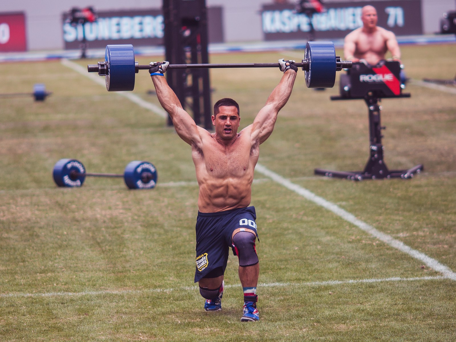 Jason Khalipa performing an Overhead Walking Lunge with 135lbs while competing at the 2014 Reebok CrossFit Games on July 23, 2014 in Carson, California. Patrick.Loera