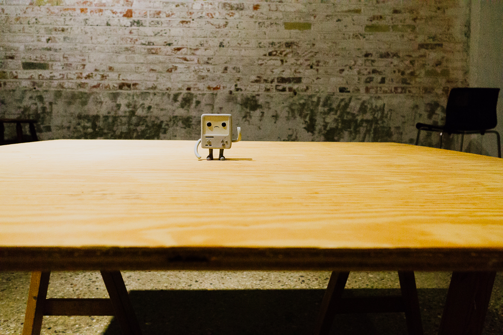 BMO sitting on top of the table for the work.