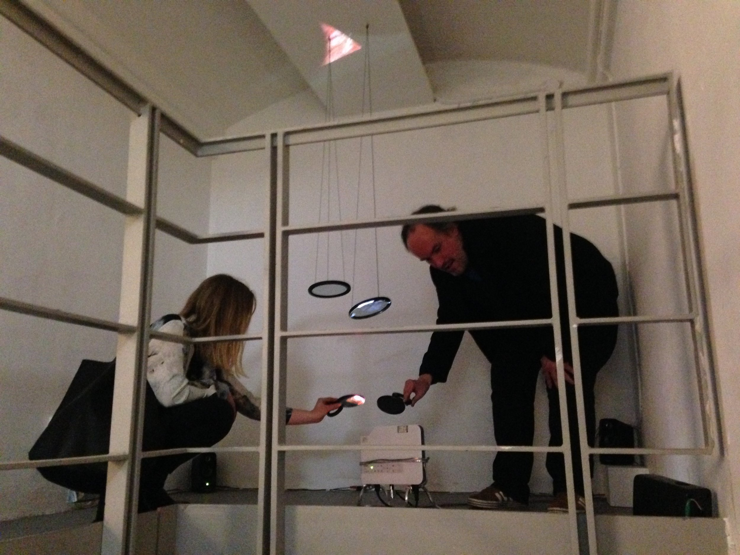 Two viewers exploring the projection using handheld mirrors