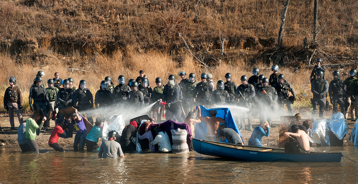 Morton County sheriff's deputies pepper-spray protestors Nov. 2, 2016 at a demonstration against the Dakota Access Pipeline near Cannonball, North Dakota.