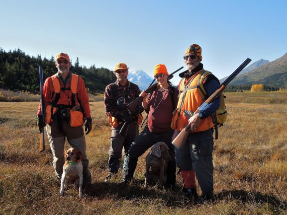 Our hunting group takes a break in willow ptarmigan country. From left to right: Keith, Mark, Gina, and Bart. Not to mention Dory and Luna.