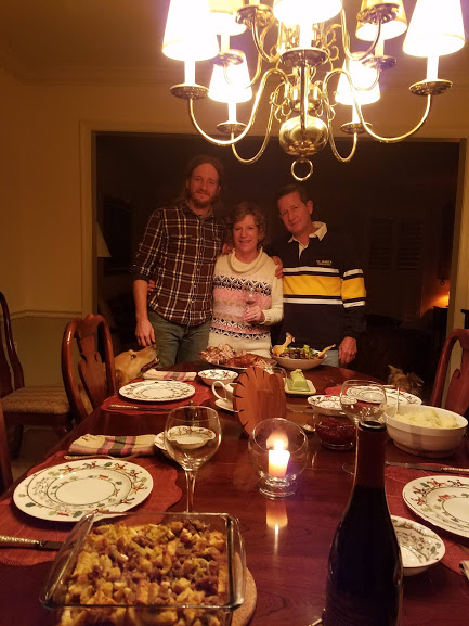 Bryan and parents at the Thanksgiving table.