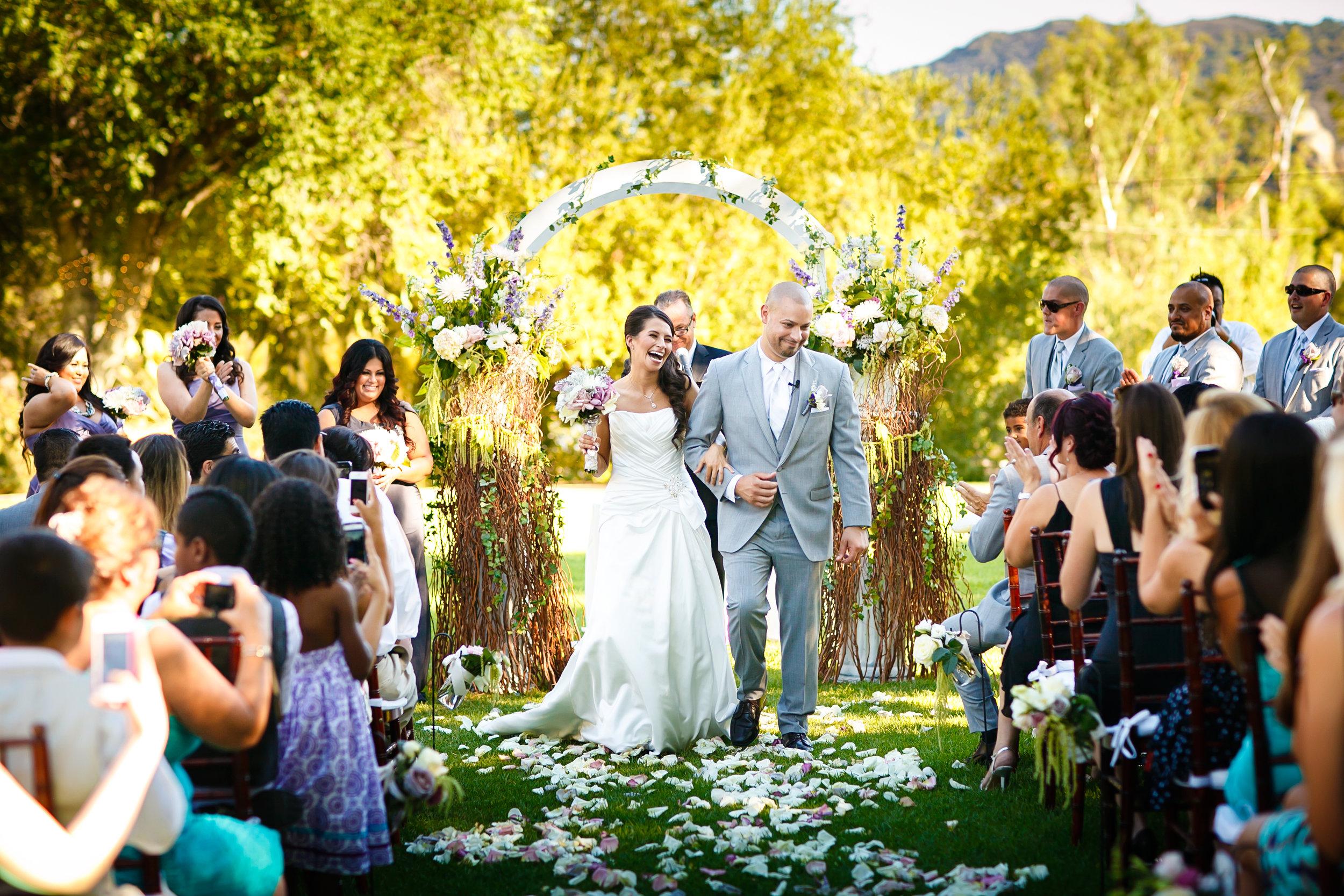 WEDDING CEREMONY AT MALIBOU LAKE IN MALIBU, CALIFORNIA