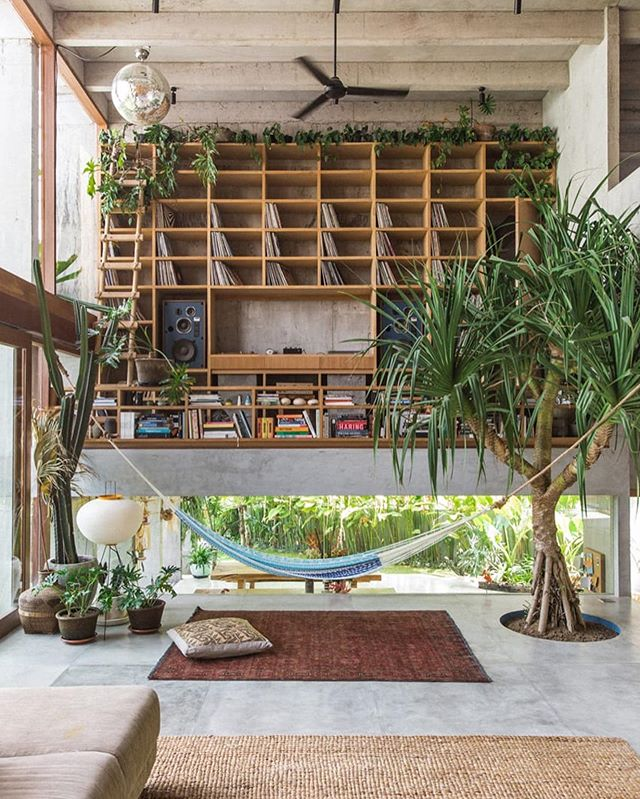 Tropical Paradise 🌴 Inside Daniel Mitchell's Concrete House in Bali by Patisandhika  #architecture #interiors #tropicalparadise #design #interiordesign #patisandhika #patisandhikaarchitects #bali #paradise #hammock #tropicalcolors #concretehouse #concretedesign #naturalhome #naturalhouse #bohodecor #bohemianhome #palmtree #bohovibes #architecturedigest #elledecor #dwell #wallpapermagazine #worldofinteriors