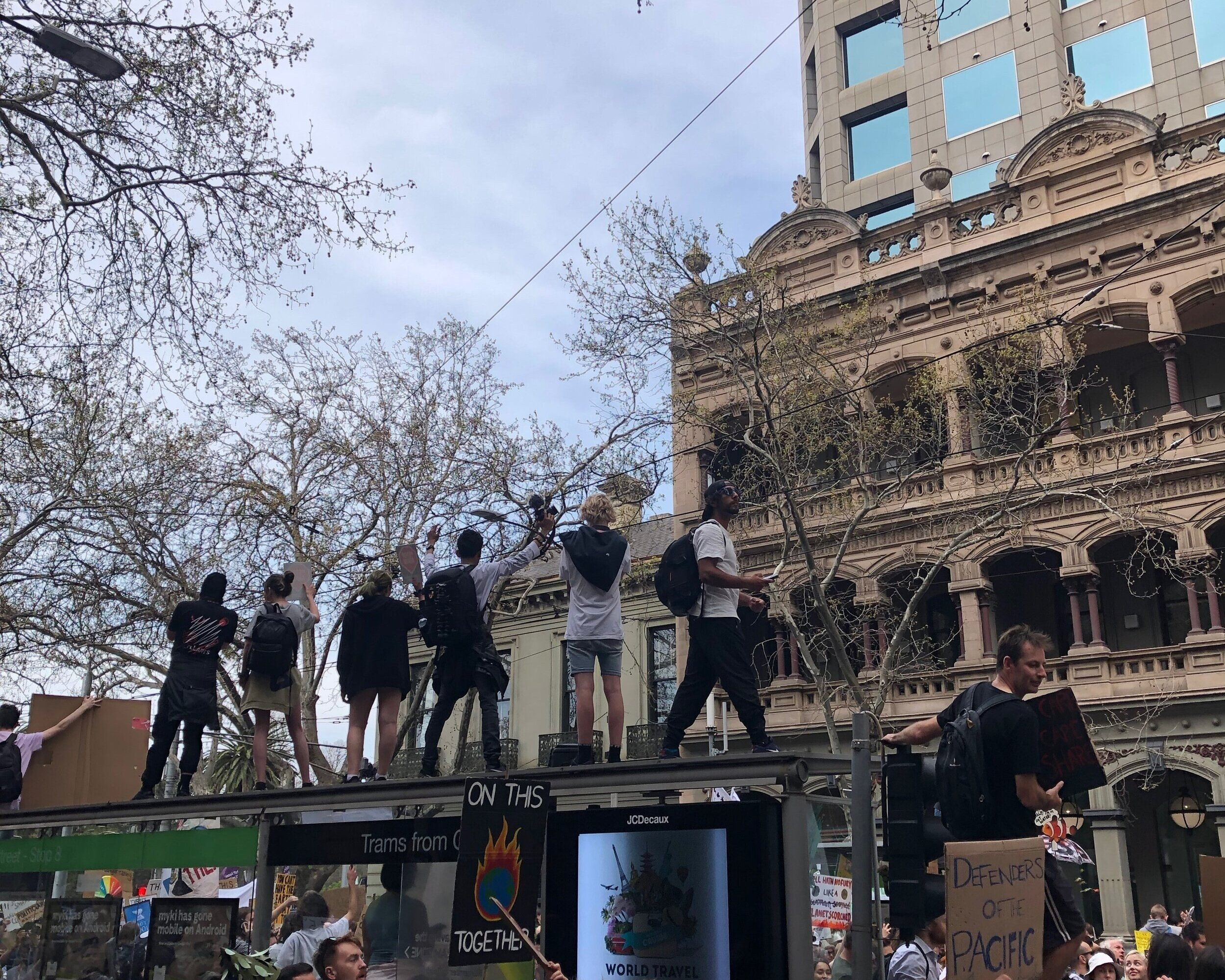 Young protestors atop tram stations. Photograph by Coral Huckstep