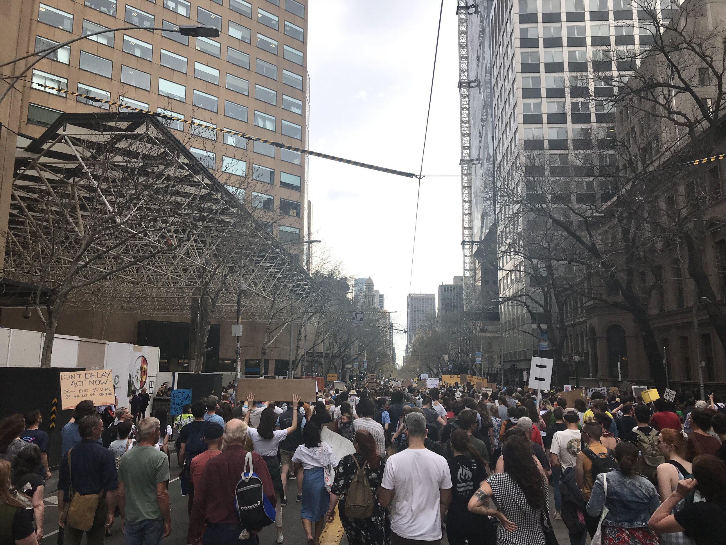 The rally moving into Melbourne CBD. Photograph by Sophie O'Shea
