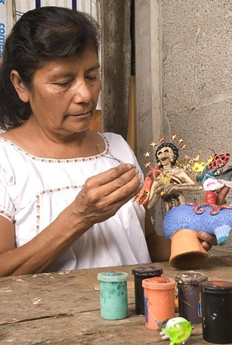 Friends of Oaxacan Folk Art — Painted red #2.jpeg