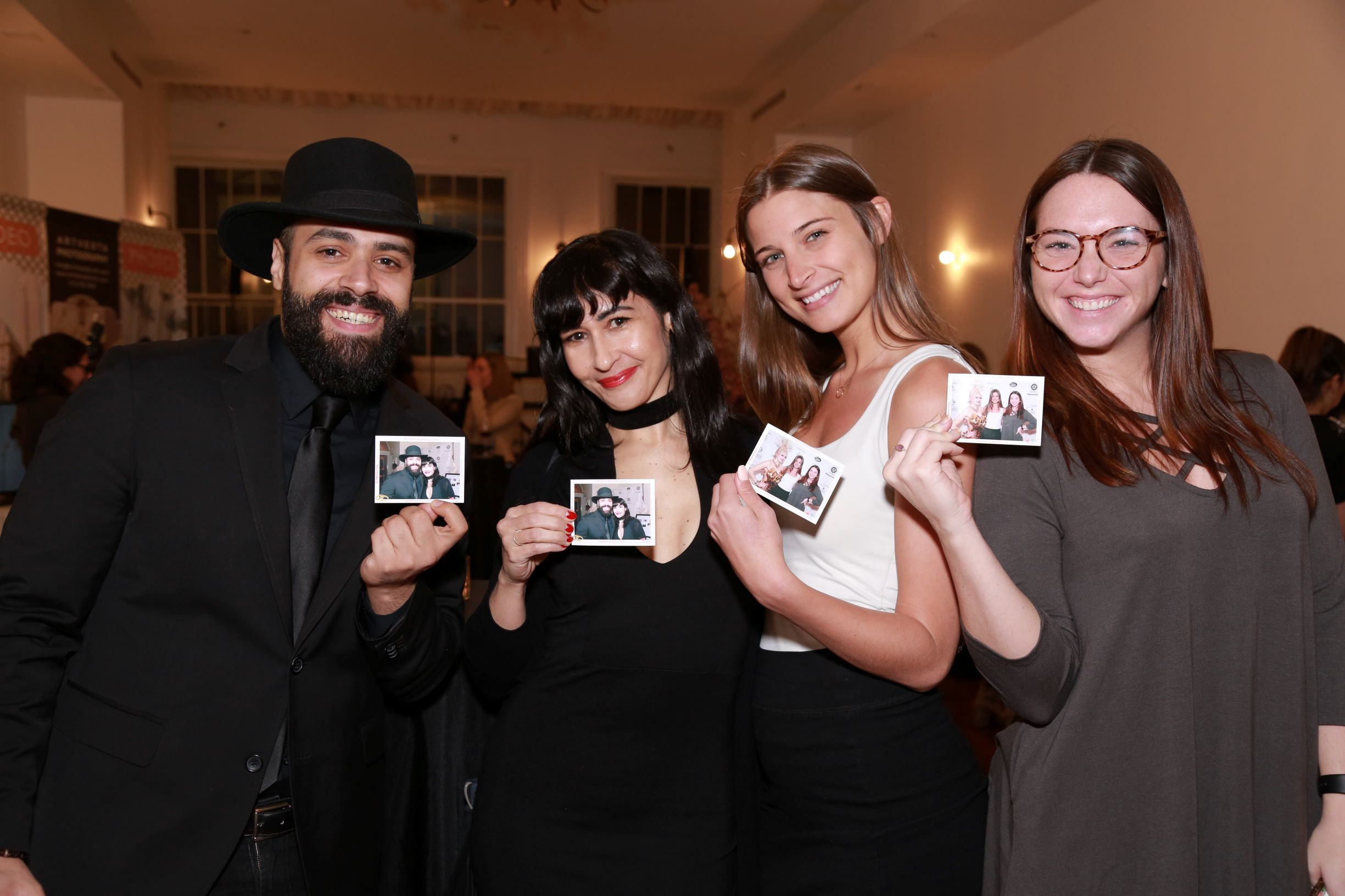 Event guests showcasing their personalized event magnets captured by Memoristic roaming magnet photographer.