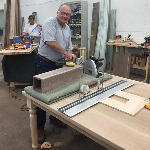 Chris   A true Renaissance man, Chris has been building and designing furniture for years, and he seems to be able to solve any problem that pops up. He plays an important role in every step of the table-making process here at Lorimer.