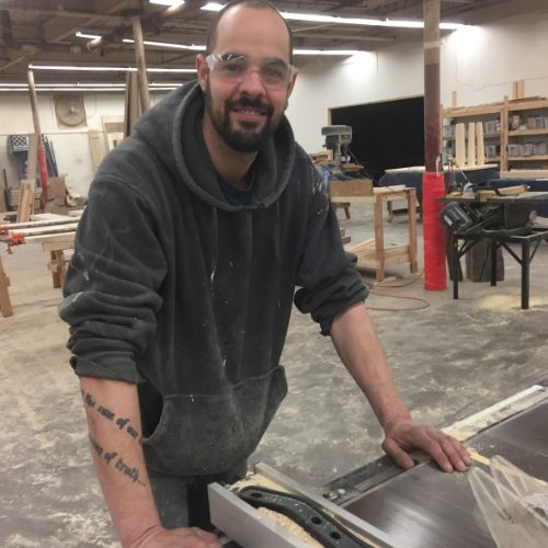Nick   Nick came to us after many years of working with granite and stone. He is our resident lumber specialist, builds all of our tabletops, and loves spending his free time with his rescue dog, Sugar.