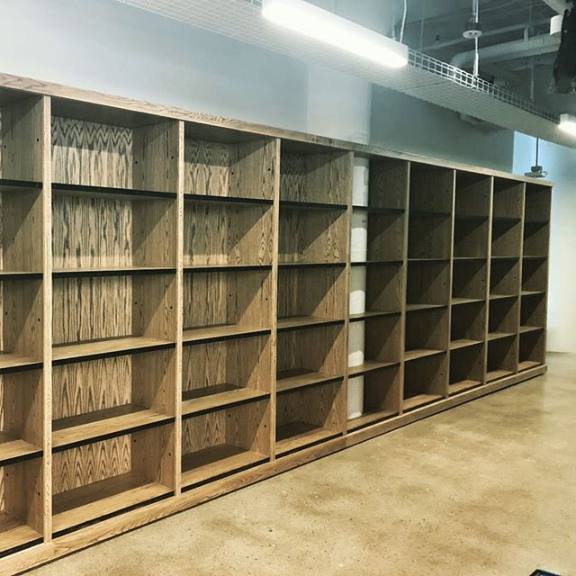 Our capabilities expand every day.  We just finished this bank of White Oak bookcases for Reebok in Boston.  We incorporated iron sections as shelf fronts.  #buylocal #buylocalri #officedesign #lorimerstudios #edgeandend #furnituredesign