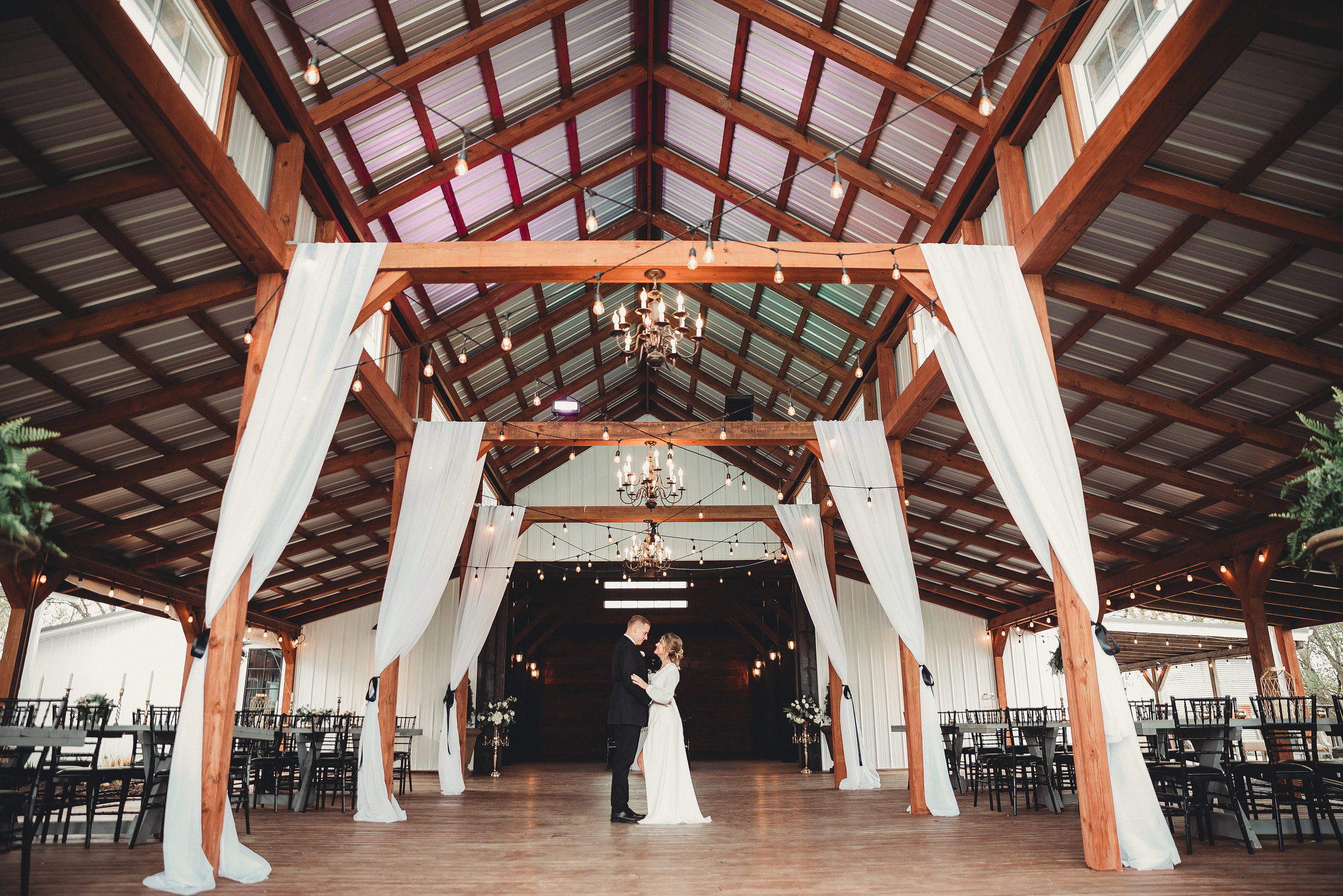 Fabric Draping: - SBD offers fabric draping services in white sheer 12'-24' panels accented by your choice of ribbon color & optional greenery choices at no additional cost. Service available for arches, arbors, backdrops, barn decks, etc.