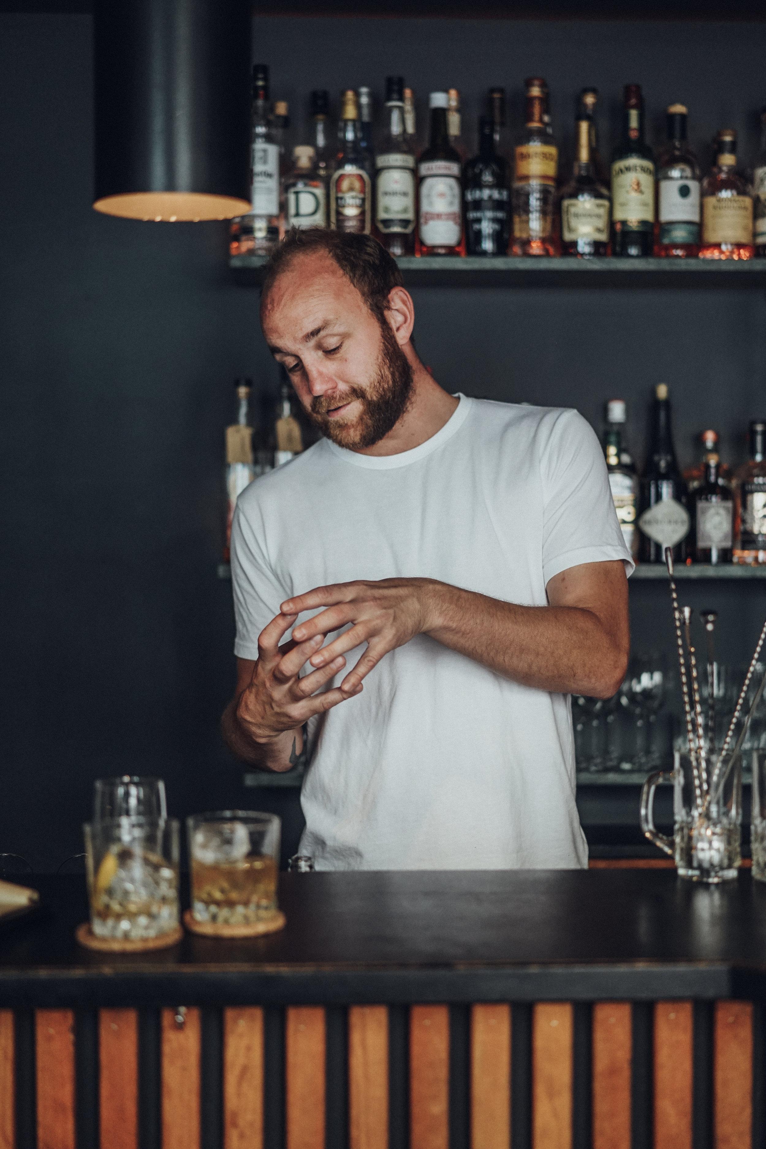 Kasper Riewe Henriksen behind the bar
