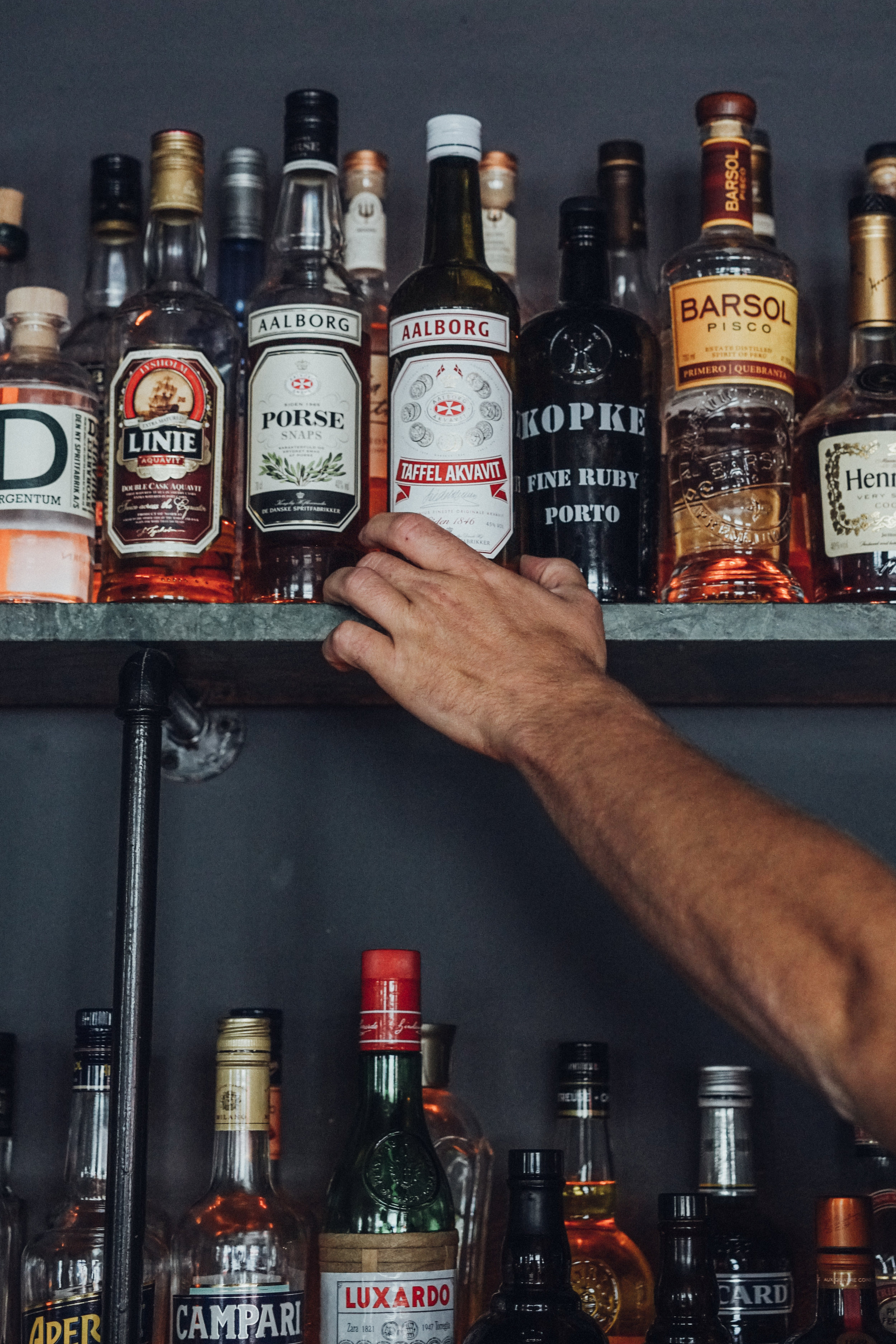 Kasper Riewe Henriksen reaching for a bottle