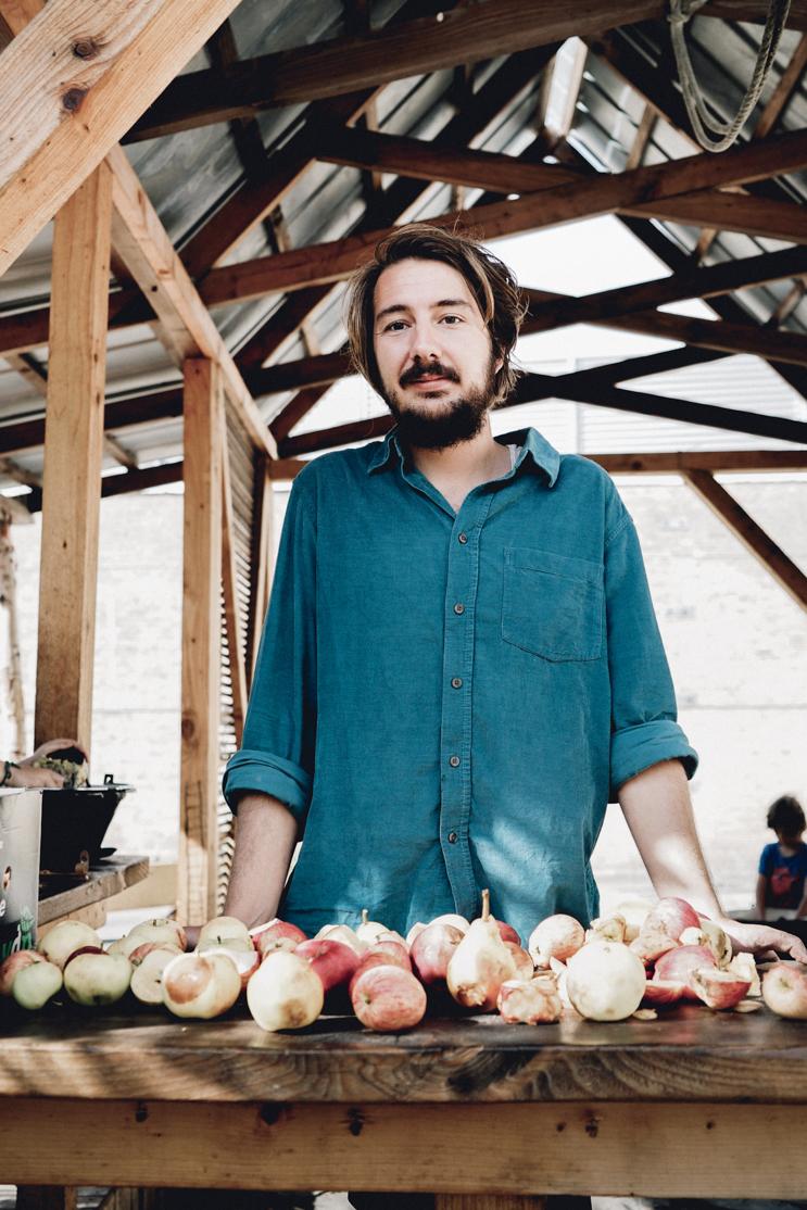 Farm teacher with apples